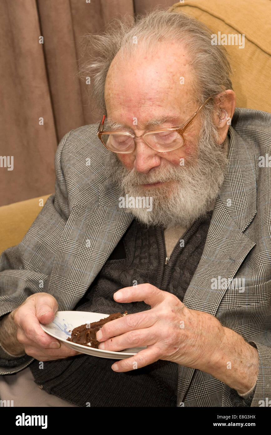 Old Man Eating Birthday Cake