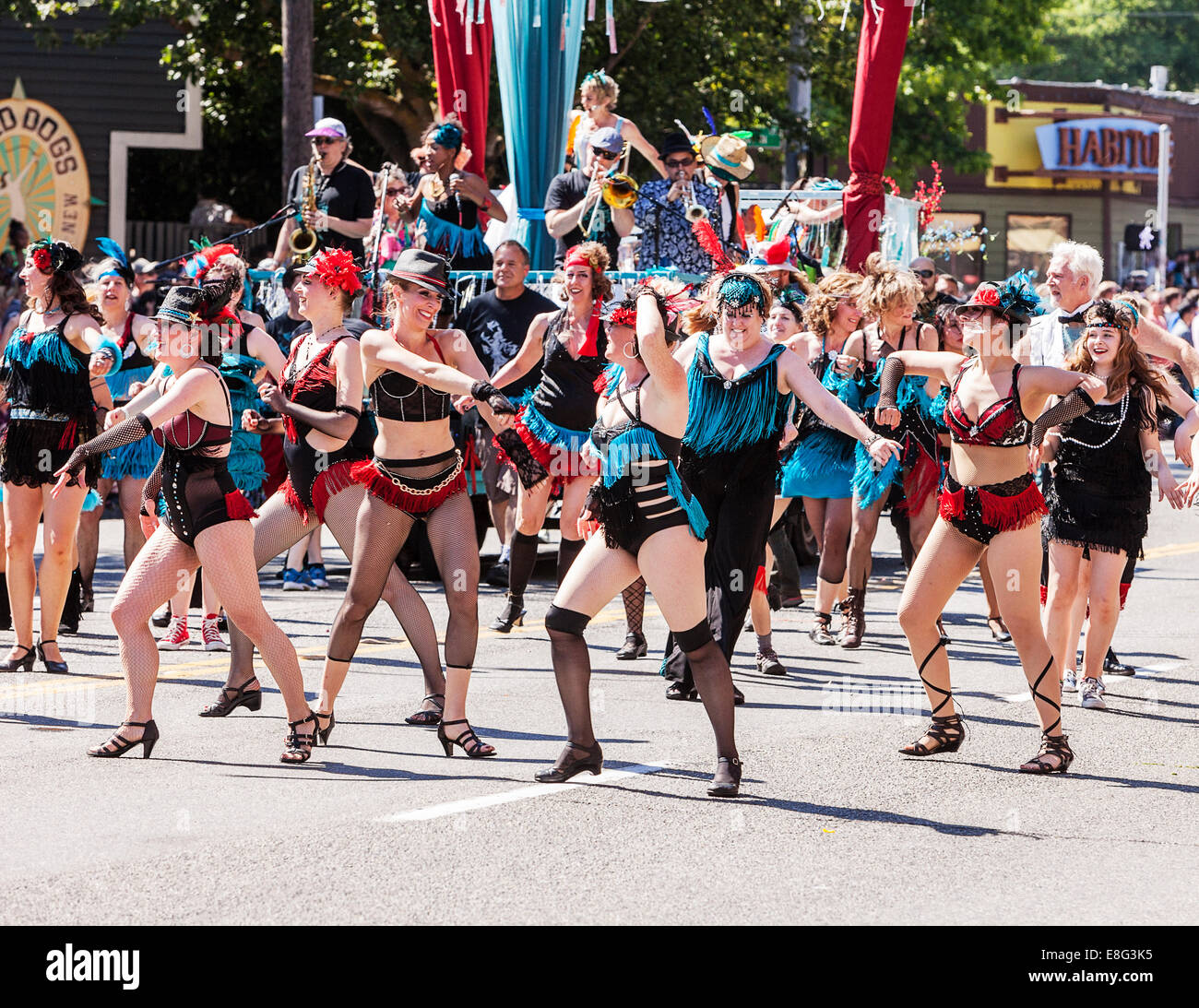 Dance Troupe Performs In Parade - Stock Image