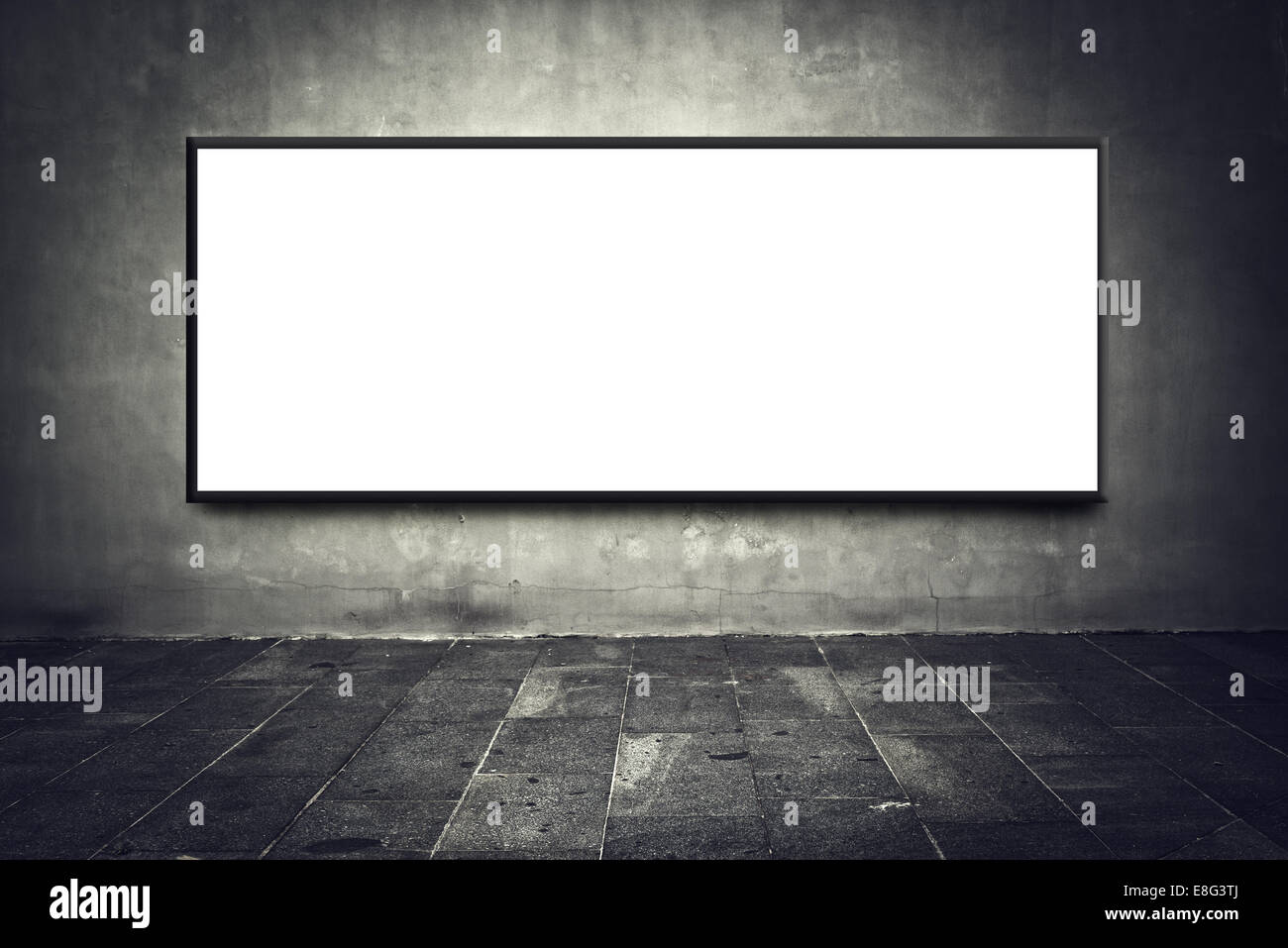 Blank billboard as copy space on gray street wall, urban outdoor advertising backdrop. - Stock Image