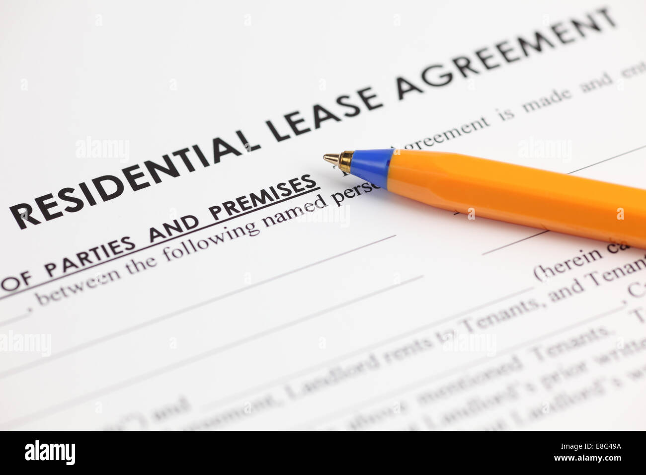 Lease agreement and ballpoint pen. Close-up. - Stock Image