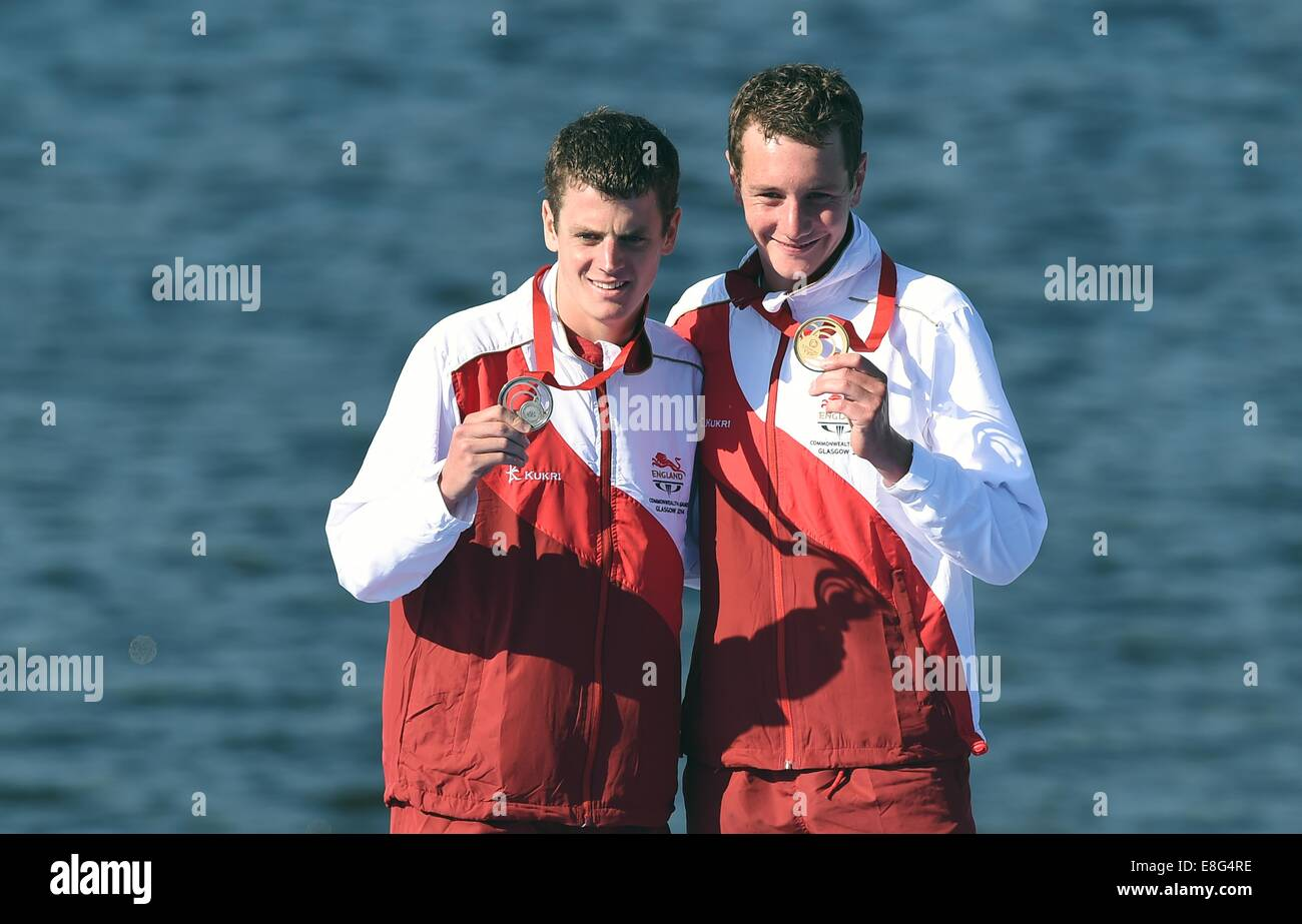 Jonathan Brownlee (ENG, left) and Alistair Brownlee (ENG) show off their silver and gold medals respectively. Triathlon. - Stock Image