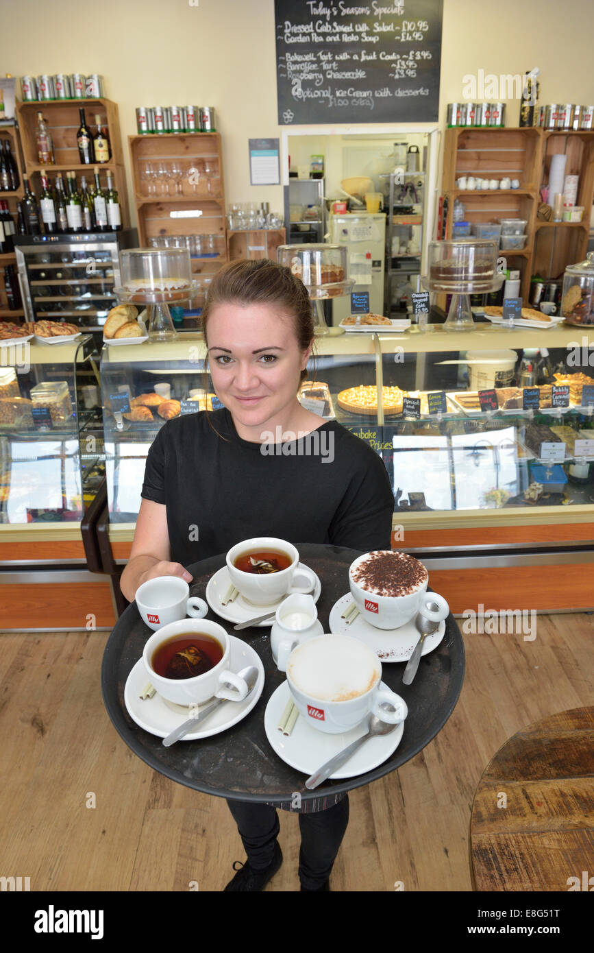 Young waitress carrying a tray of coffee at Di Lieto's Coffee Lounge, The Waterfront, Sovereign Harbour, Eastbourne - Stock Image