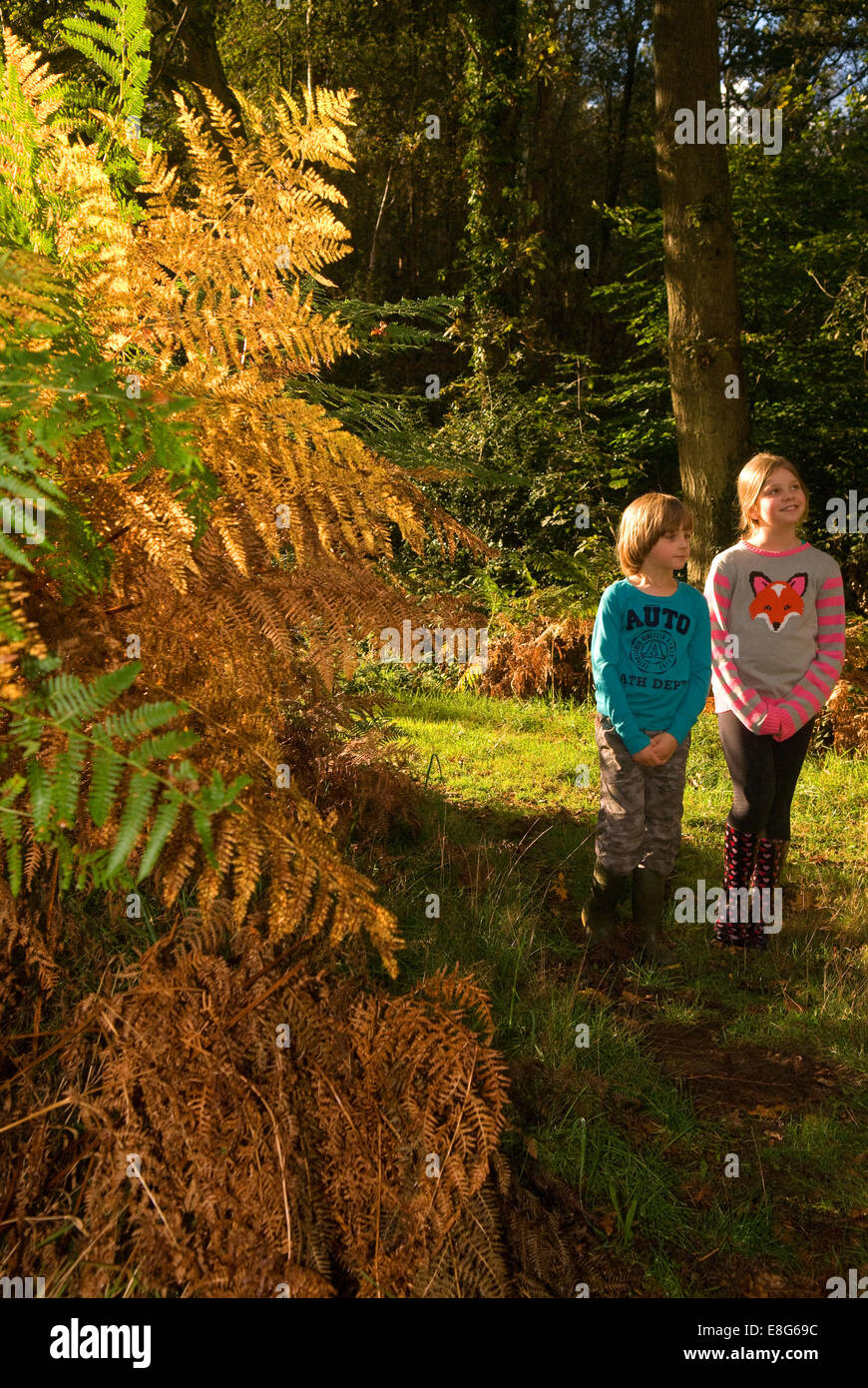 2 youngsters exploring the great outdoors, Bordon, Hampshire, UK. - Stock Image