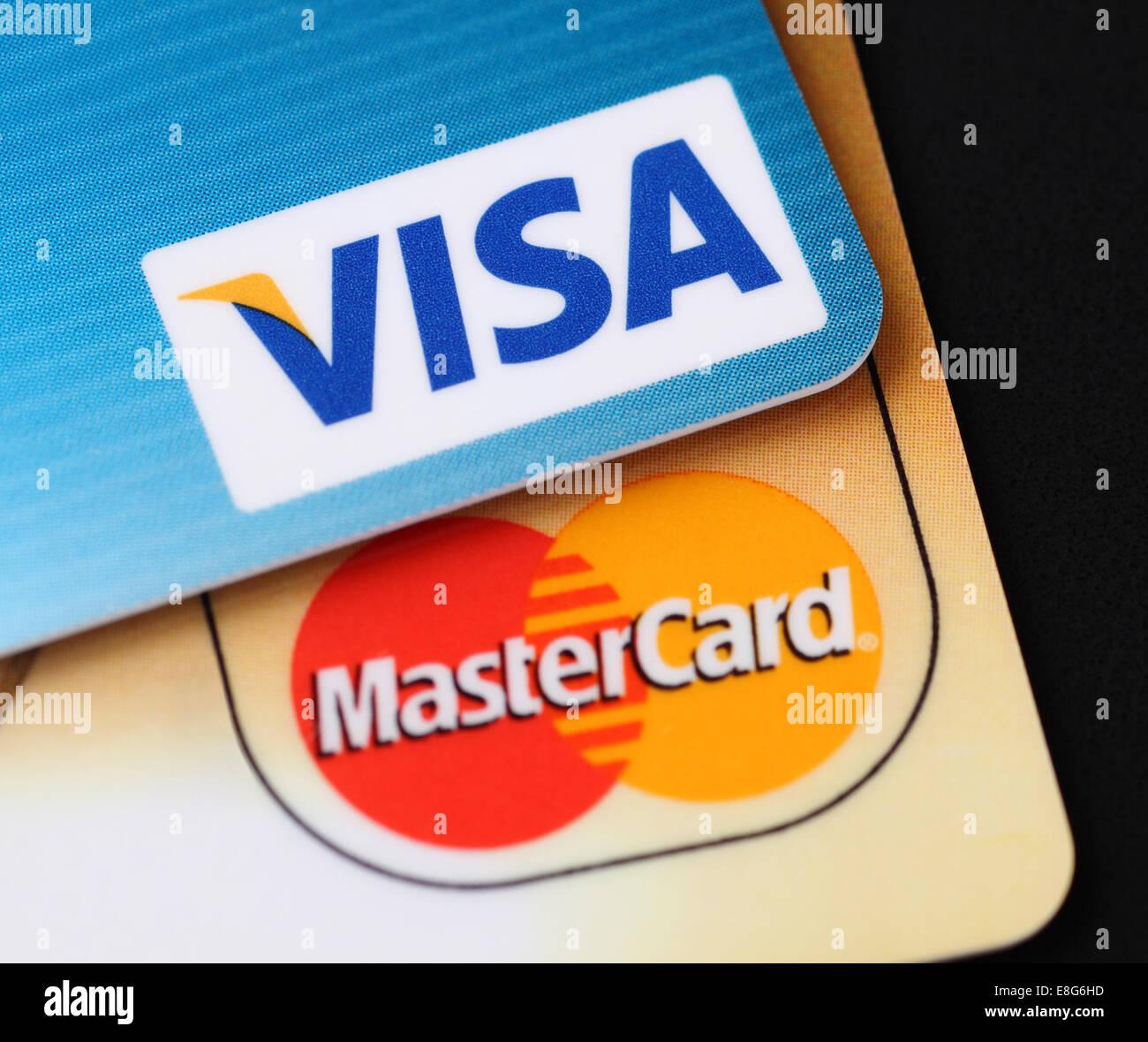 Tambov, Russian Federation - September 11, 2012 Visa and Mastercard logos on credit cards. Black background. Studio Stock Photo