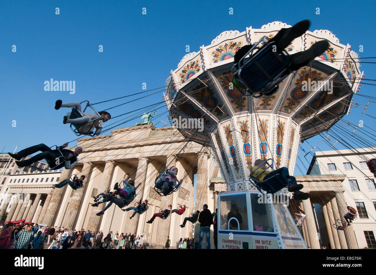 Carousel at Brandenburg Gate during street festival marking German Unity Day holiday - Stock Image