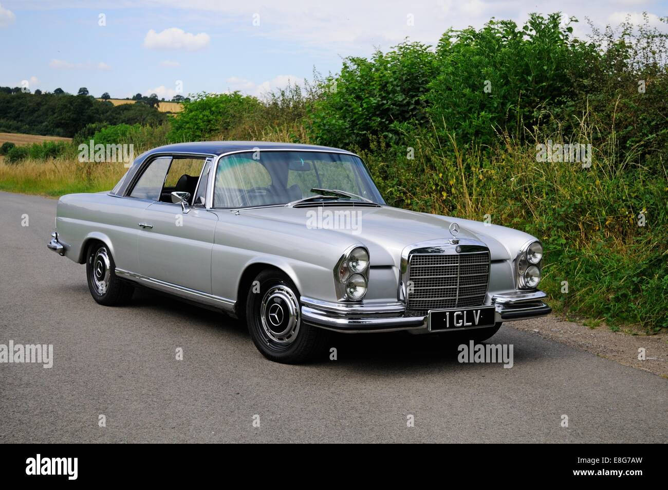 Mercedes Benz 280SE Coupe Standing By A Hedge On A Country Lane   Stock  Image