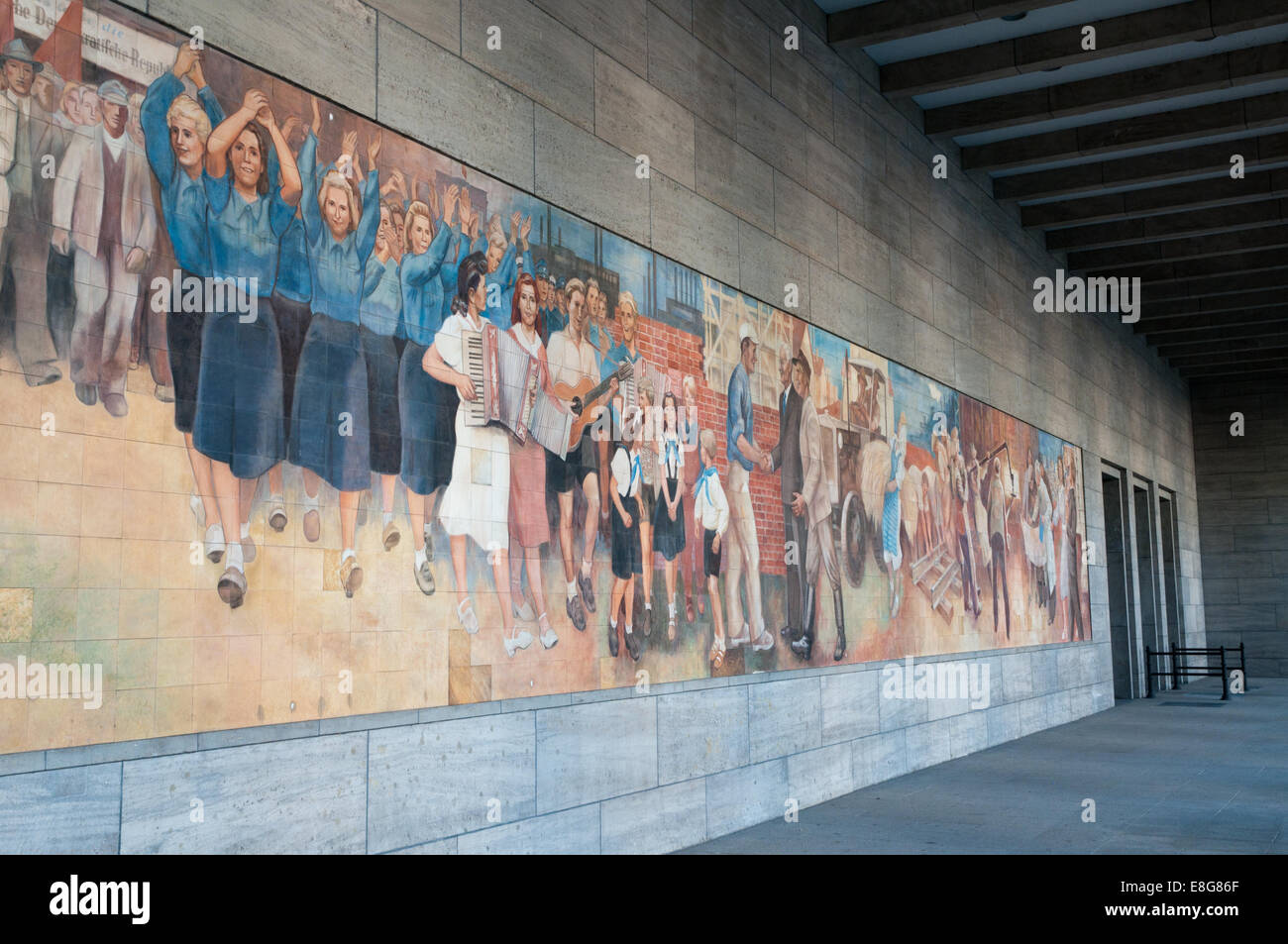 East German communist propaganda mural on wall of Finance Ministry - Stock Image