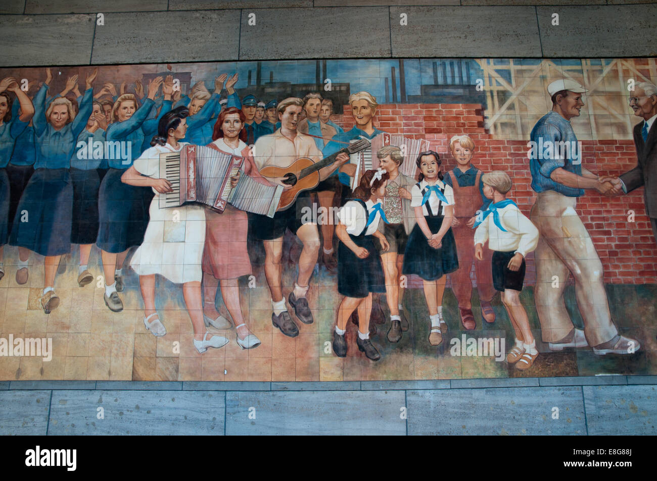 East German communist propaganda mural on wall of Finance Ministry - Stock Image