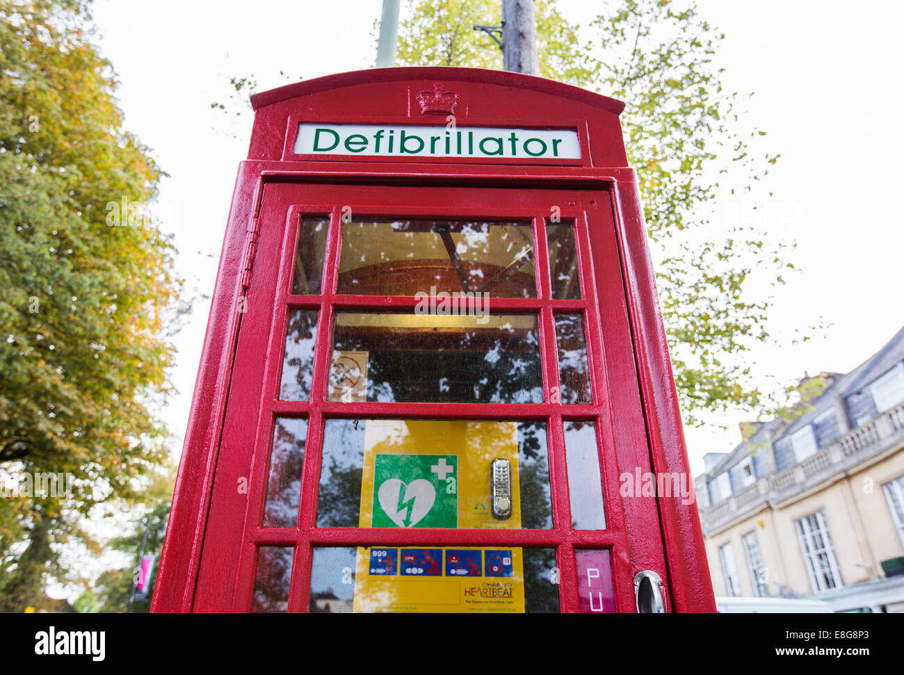 A telephone box in Cheltenham, UK, which now contains a defibrillator instead of a telephone - Stock Image