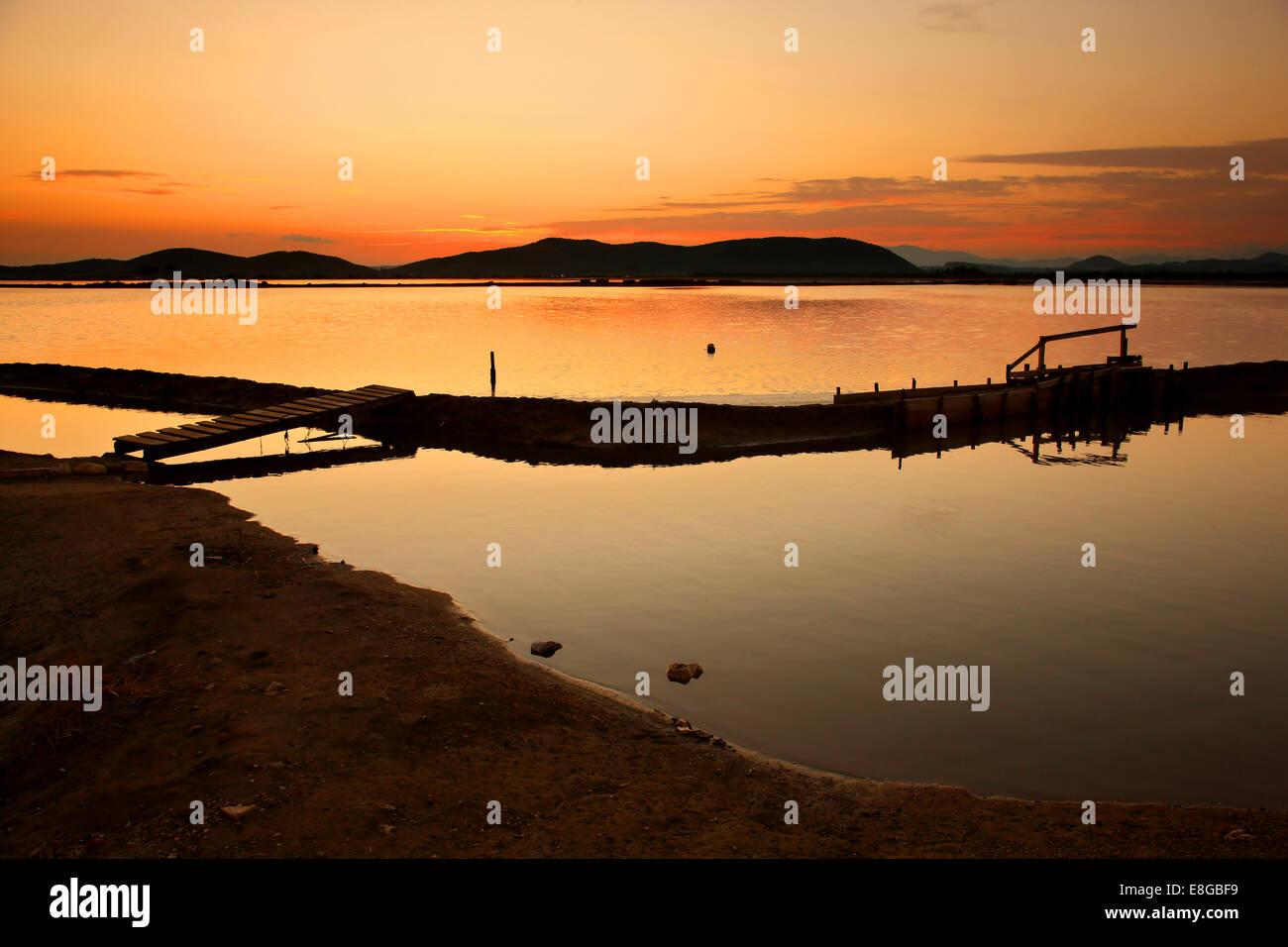 Sunset at the Canal of Foinikia (popular for mudbaths), lagoon of Messolonghi-Aitoliko, Aitoloakarnania, Greece. - Stock Image