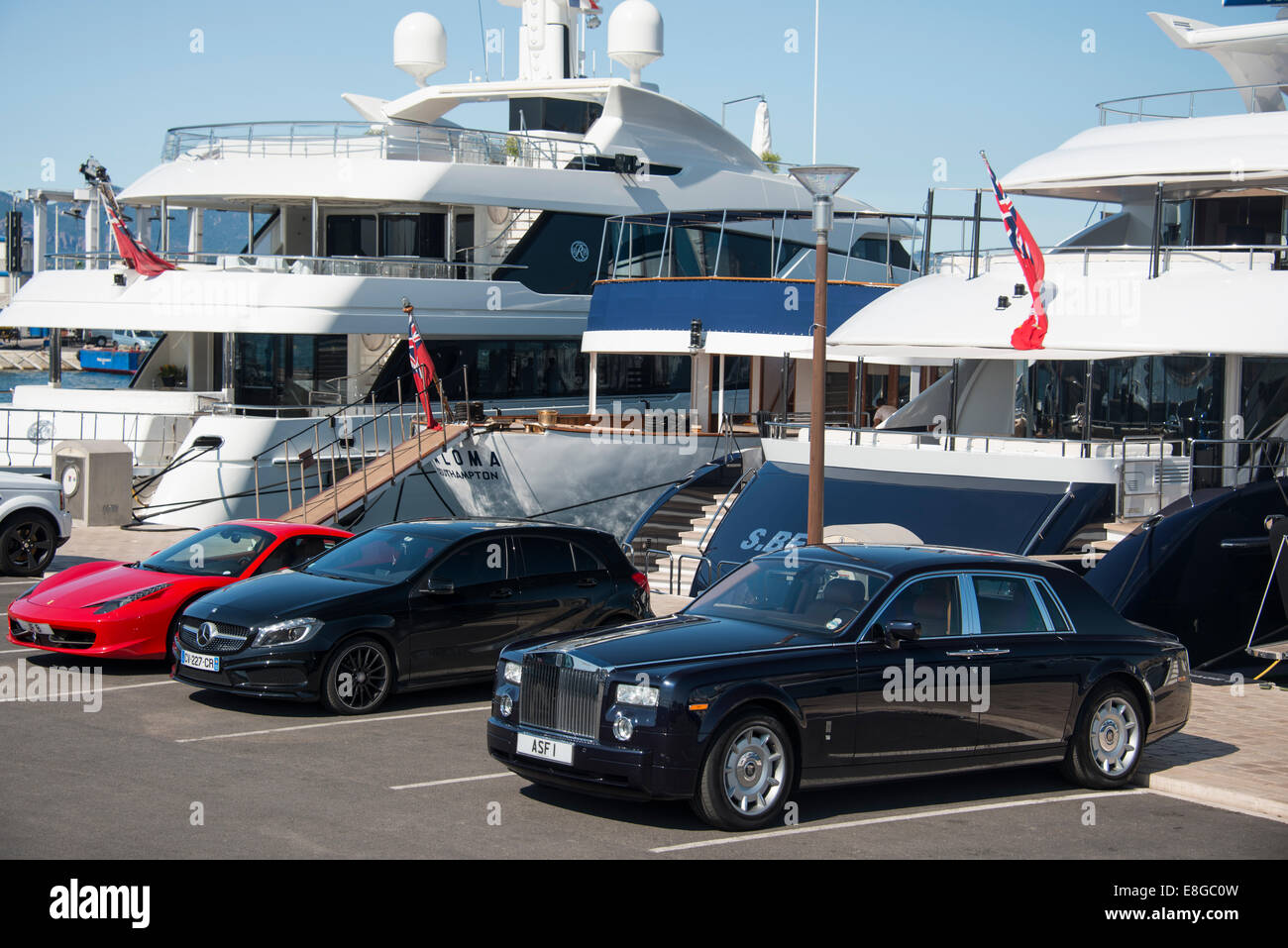 luxury cars yachts  expensive cars parked on wharf in front of luxury yachts in Cannes ...