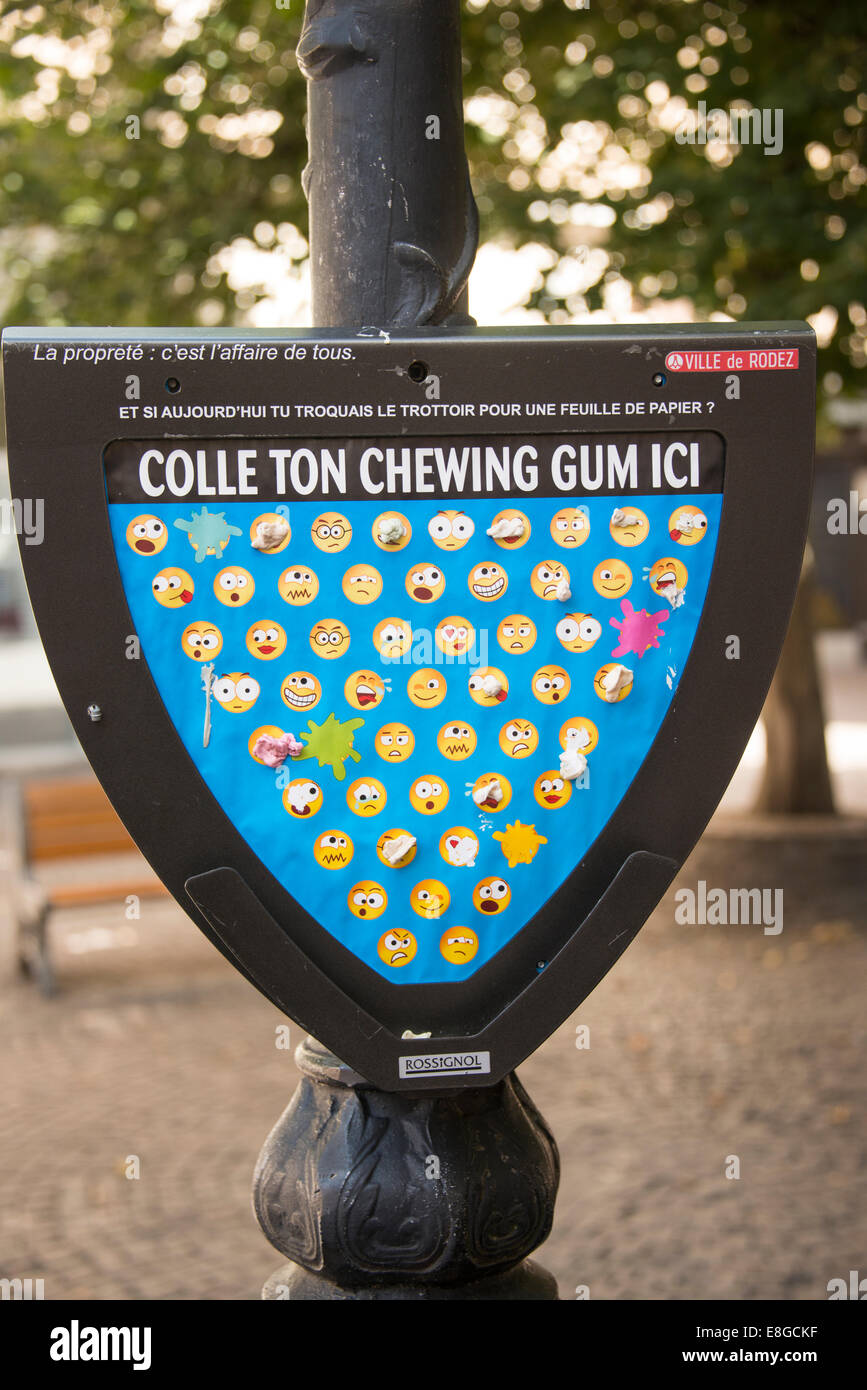 Board in square for sticking used chewing gum rather than spitting it on the ground in city of Rodez Aveyron France - Stock Image