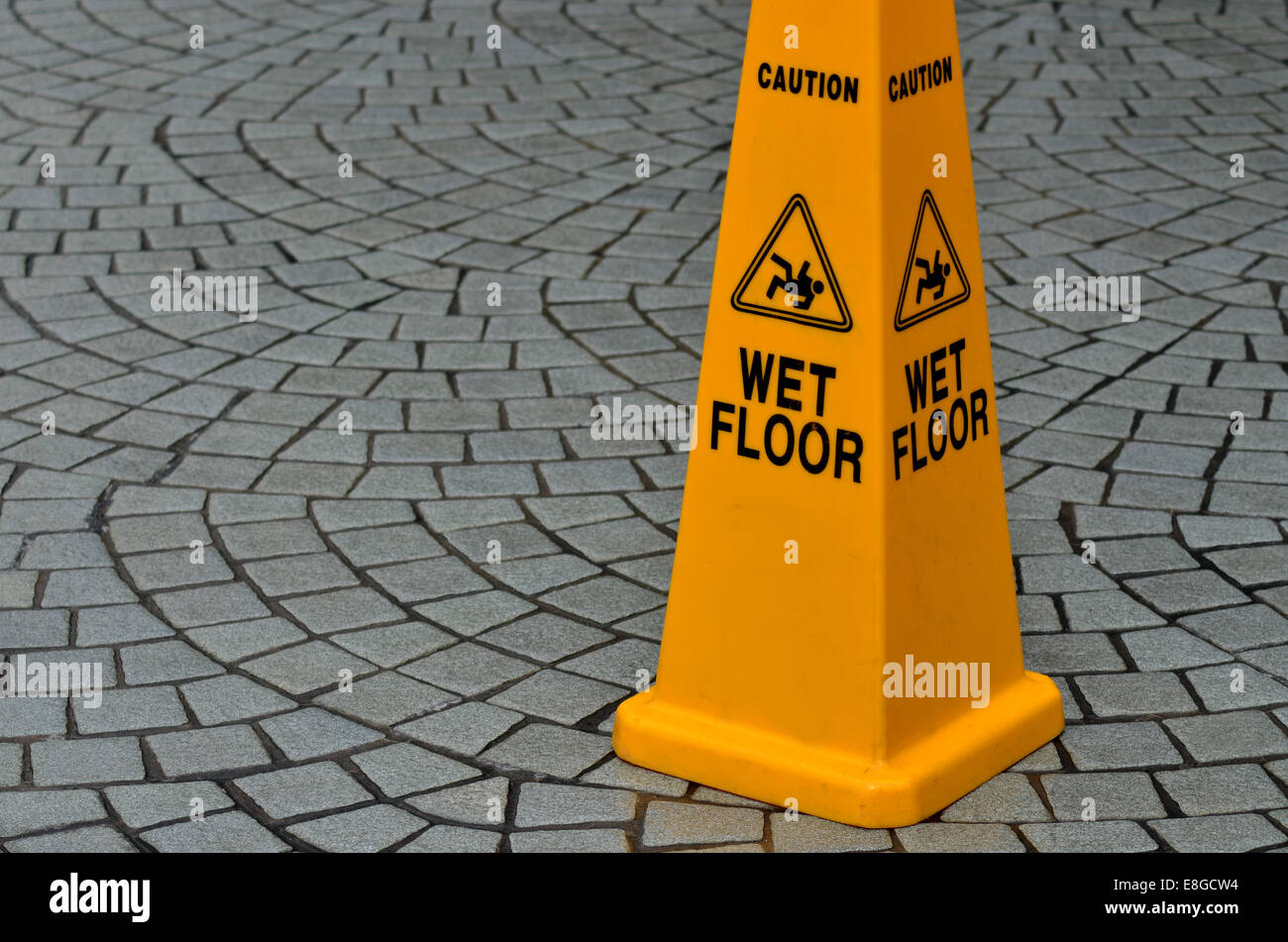 Slippery floor surface warning sign and symbol in building, hall, office, hotel , restaurant, restroom. Concept - Stock Image