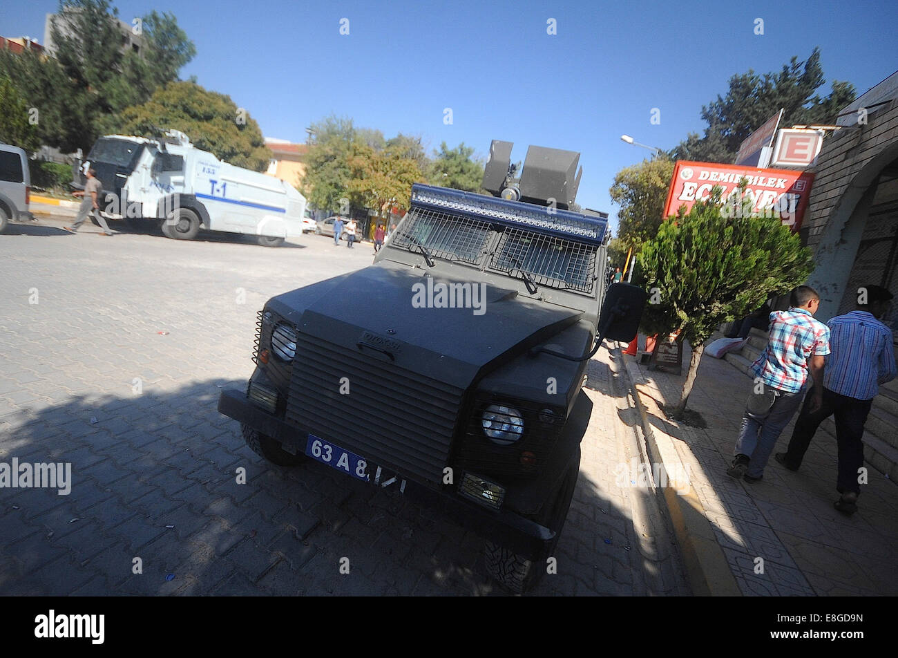 Suruc, Turkey. 7th Oct, 2014. Tear gas vehicles and water canon vehicles can be seen lining the streets in Suruc - Stock Image
