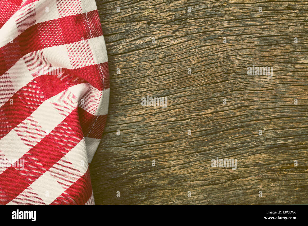 the red tablecloth over old wooden table - Stock Image