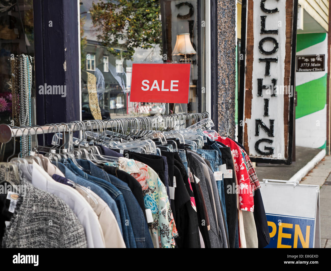 second hand used clothing store items for sale trendy hip Main Street Vancouver Canada - Stock Image