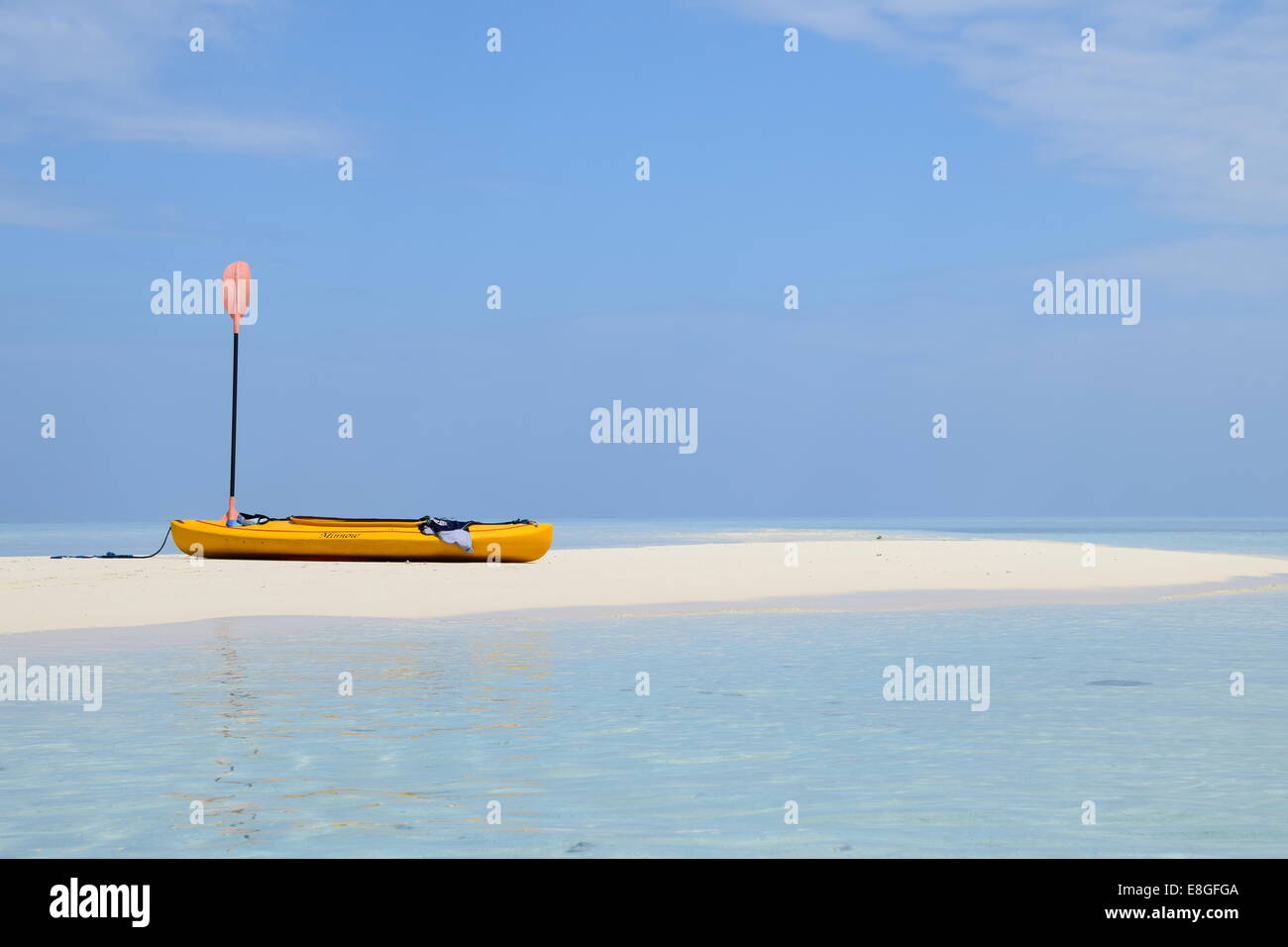 Canoe at rest on a beautiful sandbar surrounded by pristine waters - Stock Image