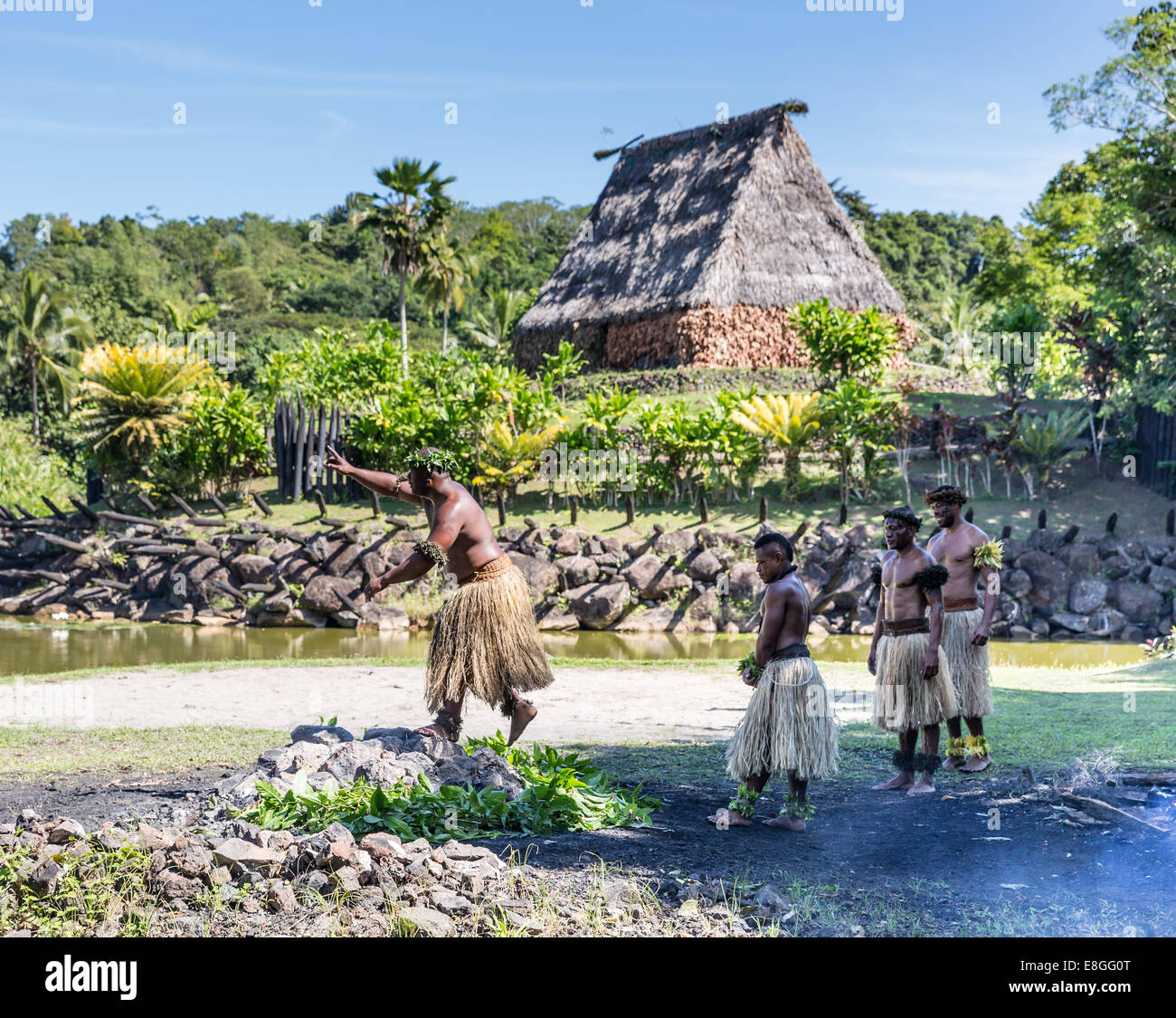 Ceremonial fire walkers crossing hot rocks at Fiji - Stock Image