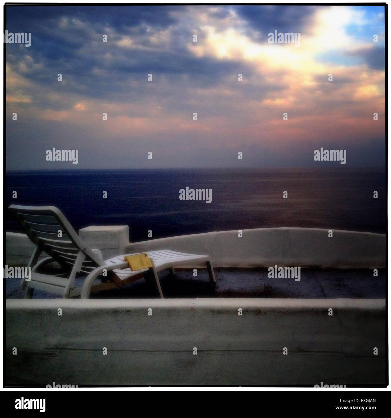 Sunbed at sunset - Stock Image