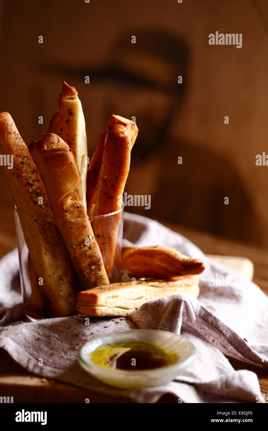 Breadsticks with olive oil and balsamic vinegar - Stock Image