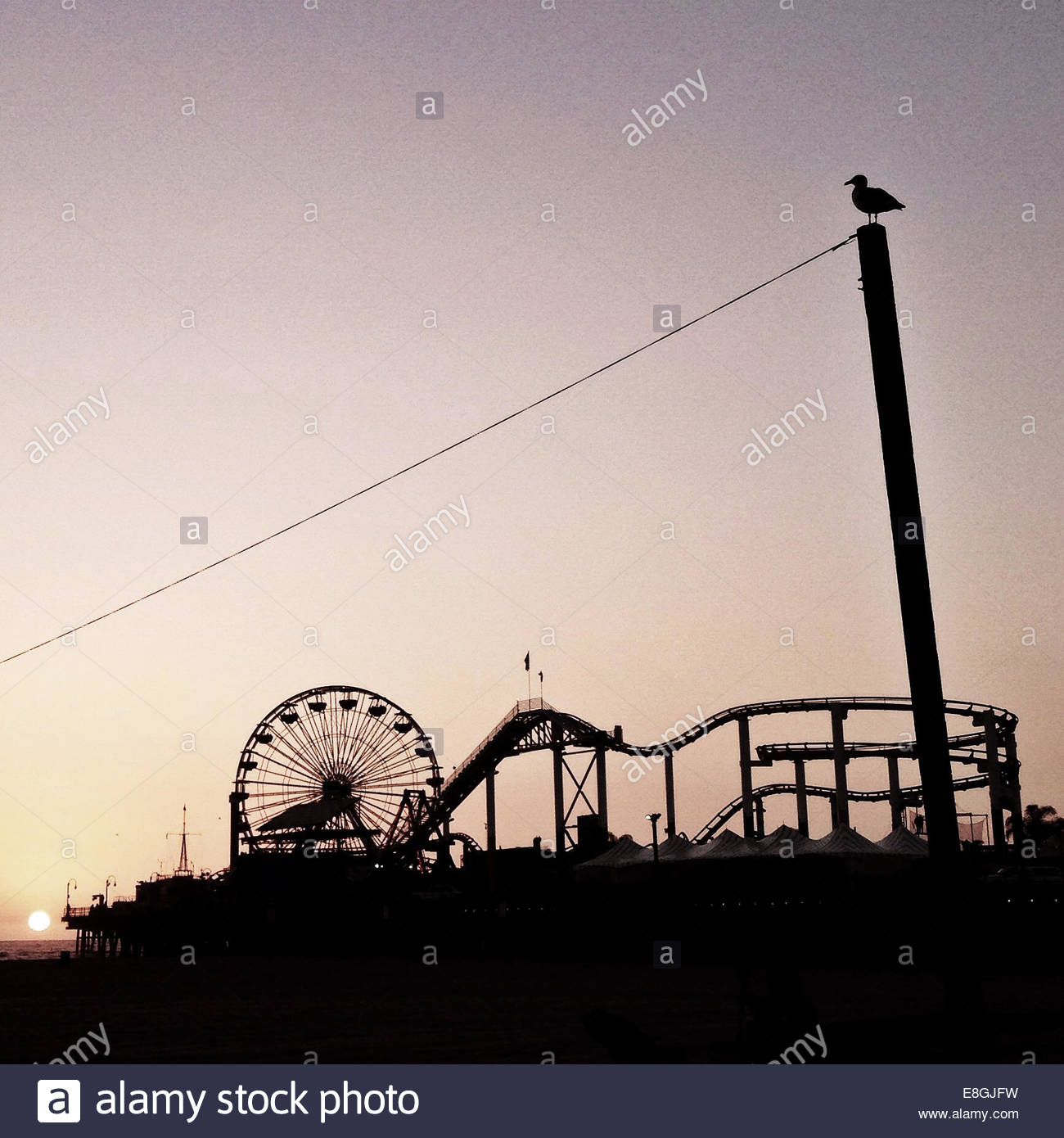 Fair ground at sunset - Stock Image