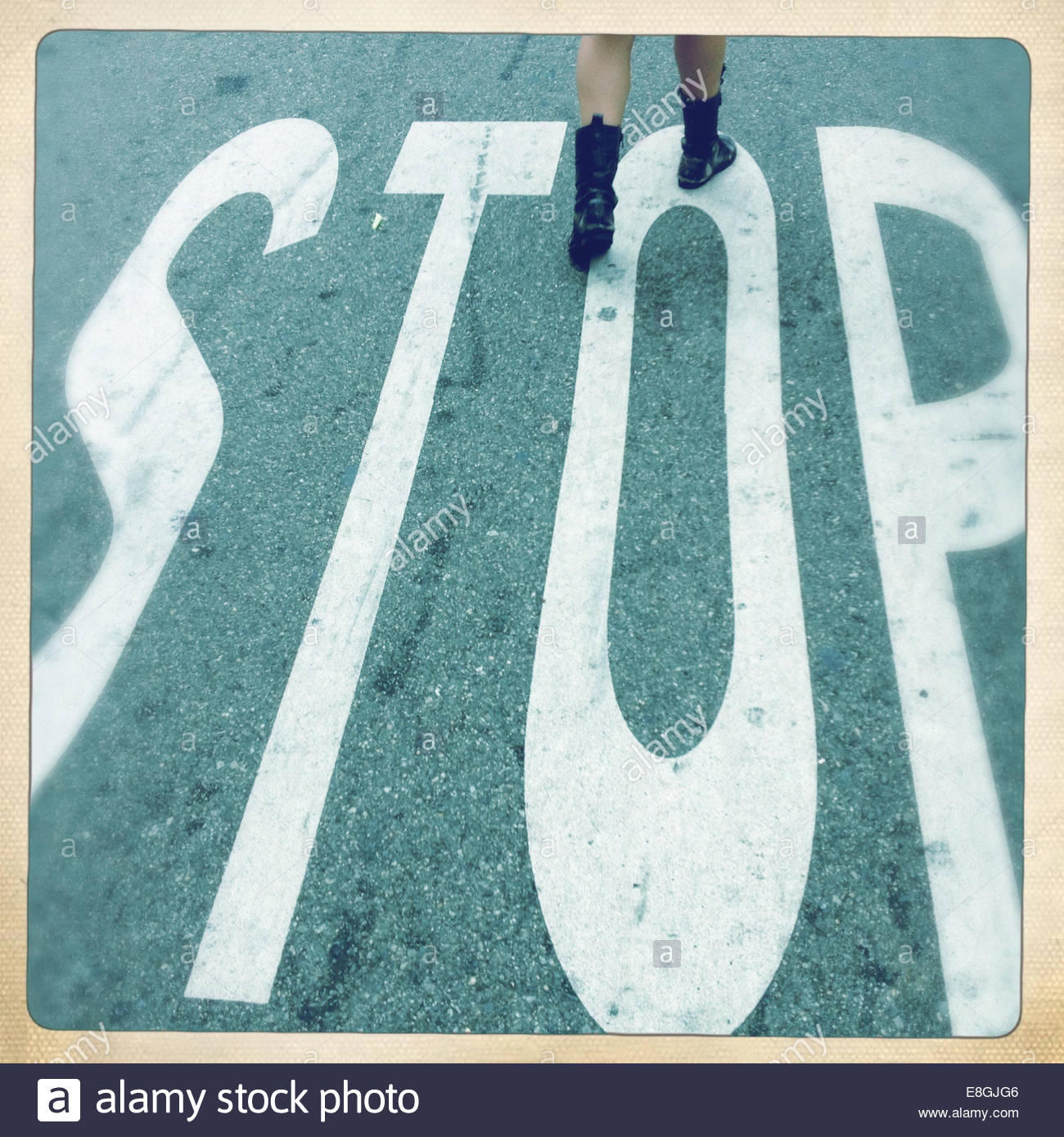 Stop warning printed on road - Stock Image