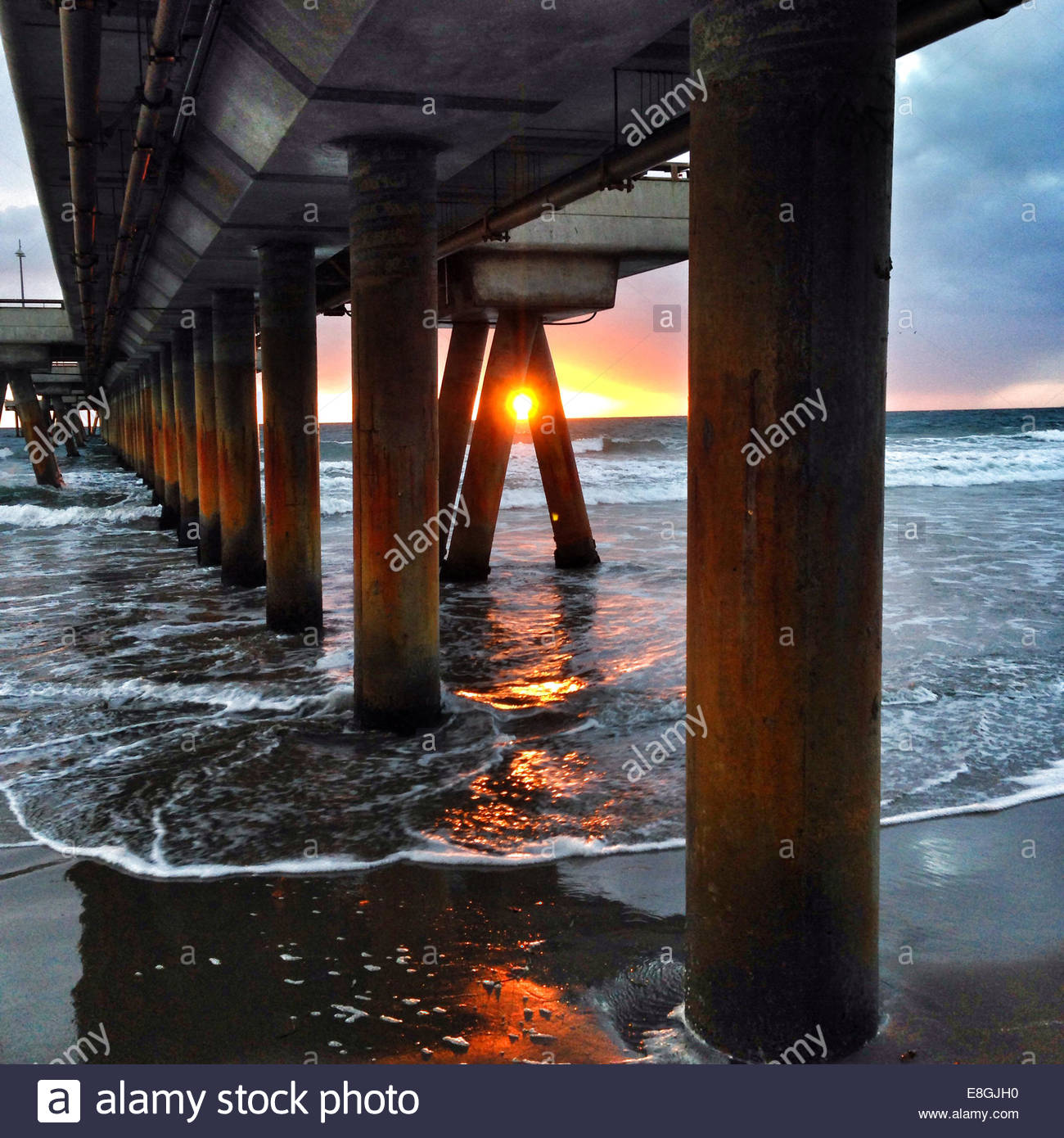 View of pier at sunset - Stock Image