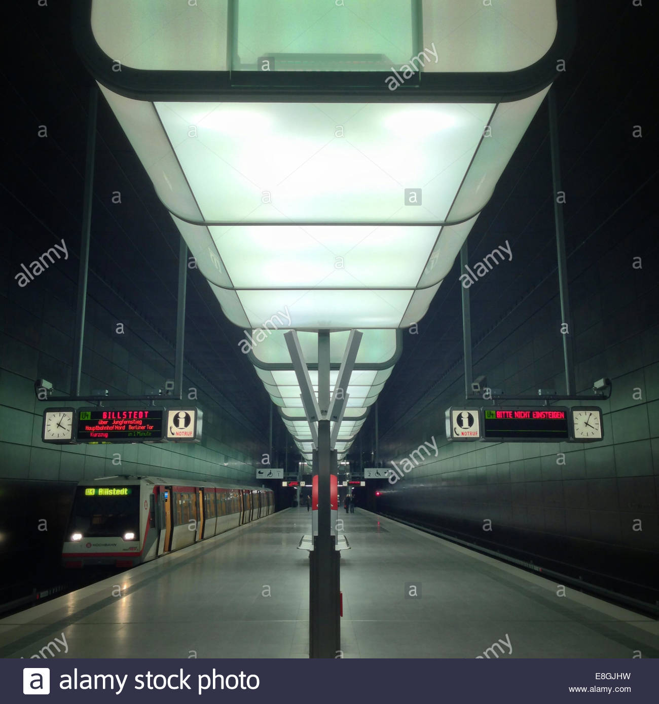 Illuminated train platform - Stock Image