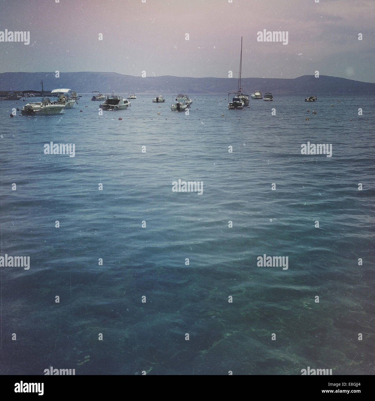 Boats anchored at sea - Stock Image