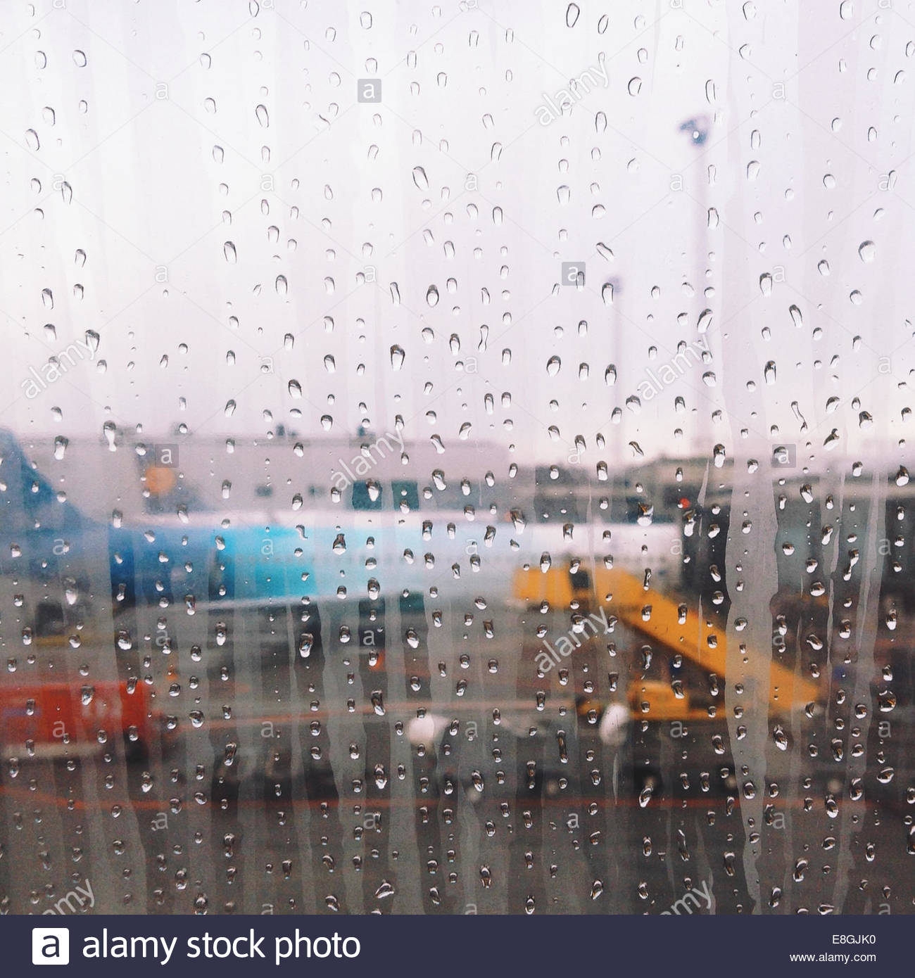 Rain on window with airport view - Stock Image