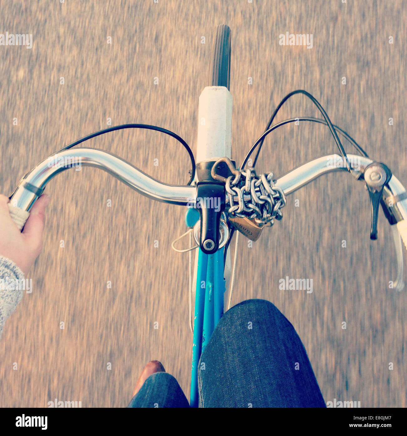 Woman cycling - Stock Image