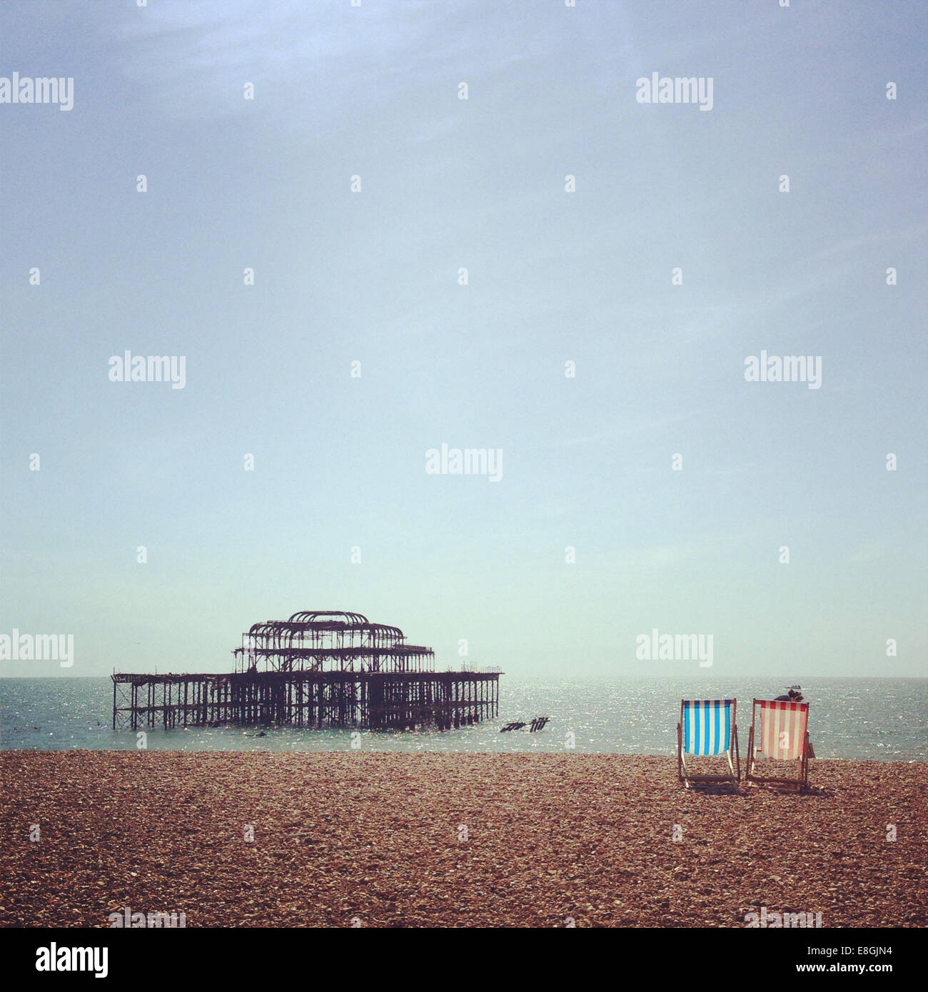 UK, England, East Sussex, Brighton, Two deck chairs on Brighton Beach - Stock Image