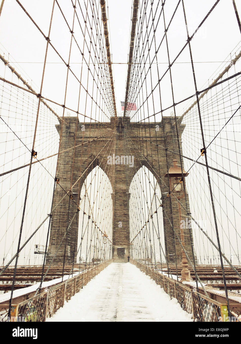 Brooklyn Bridge in snow, New York, America, USA - Stock Image