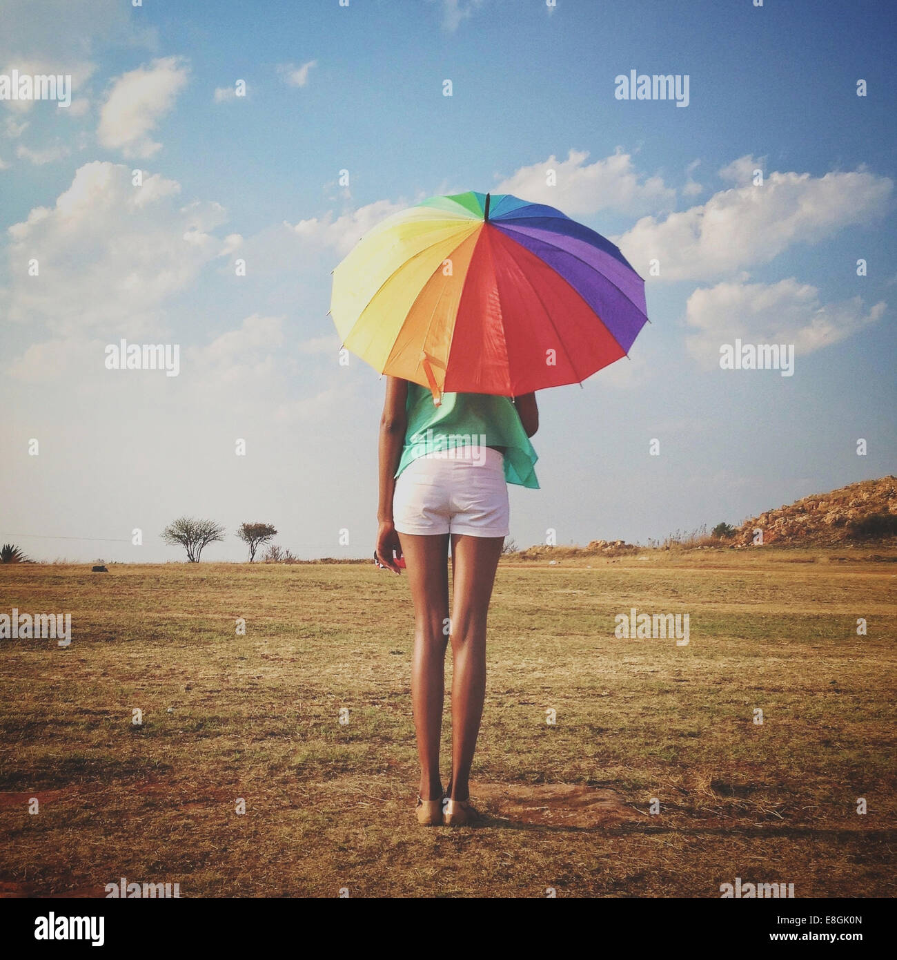 South Africa, Gauteng, Johannesburg, Roodepoort, Lady with Rainbow Umbrella - Stock Image