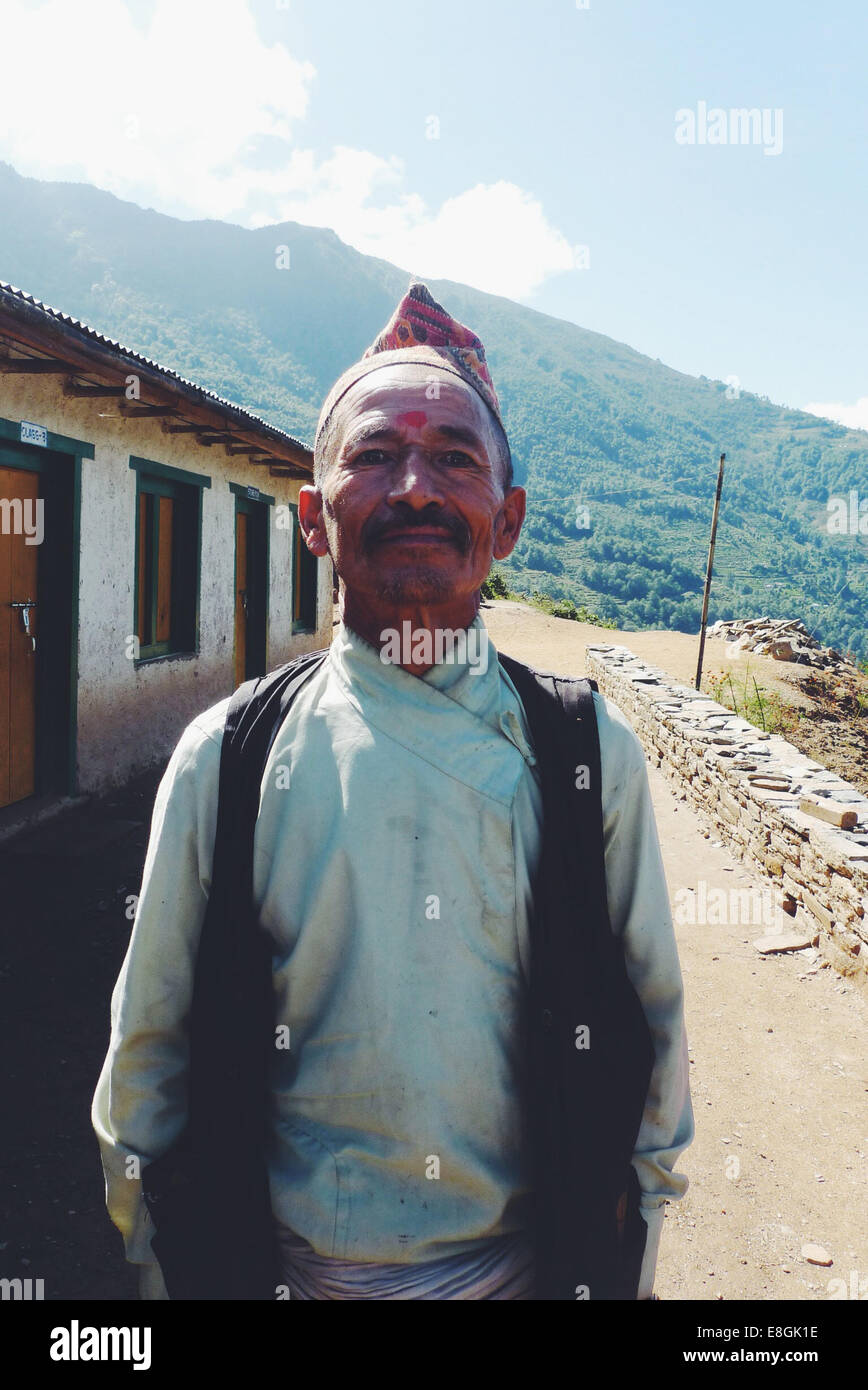 Nepal, Portrait of man standing in village - Stock Image