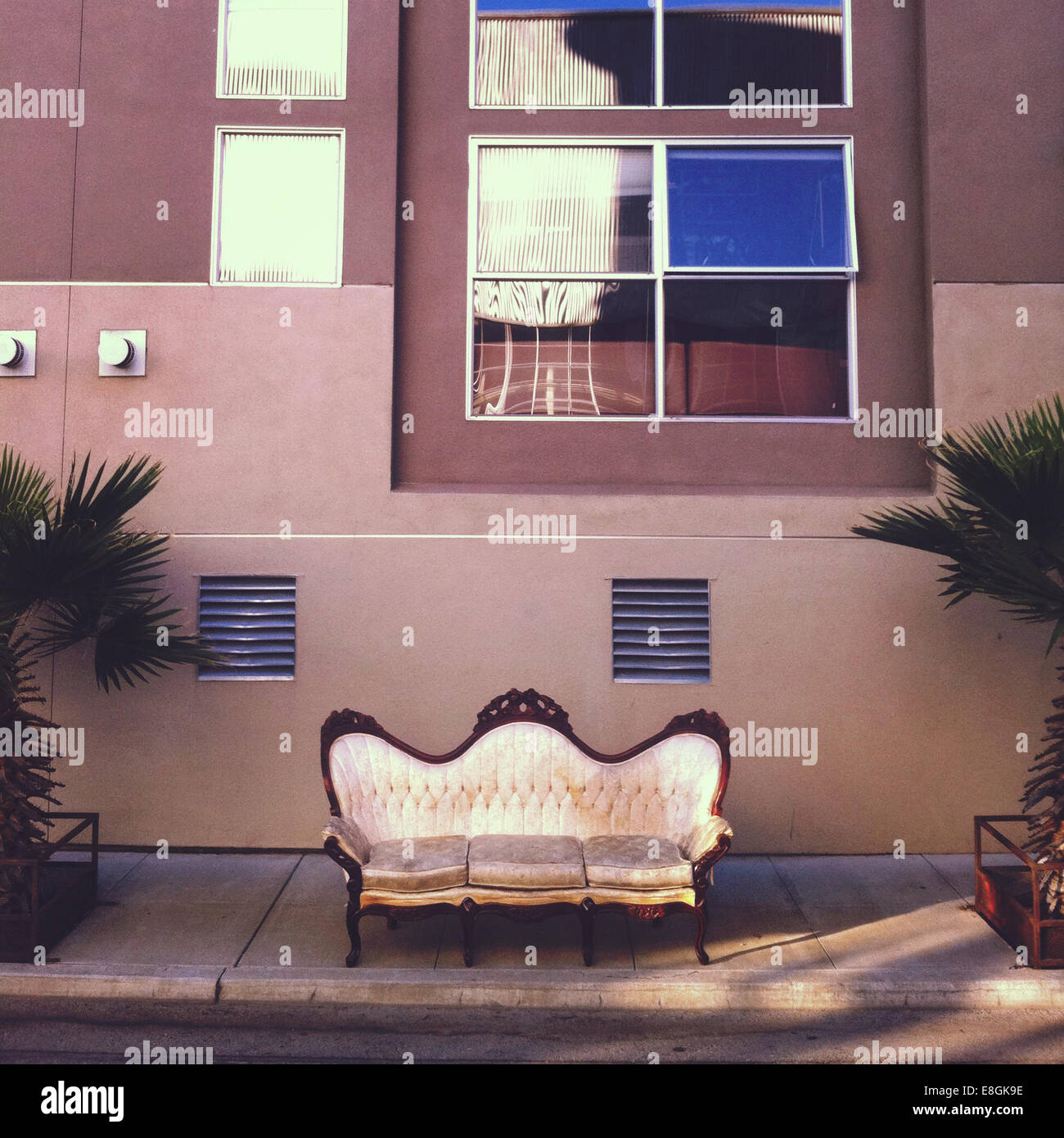 Vintage couch on sidewalk - Stock Image