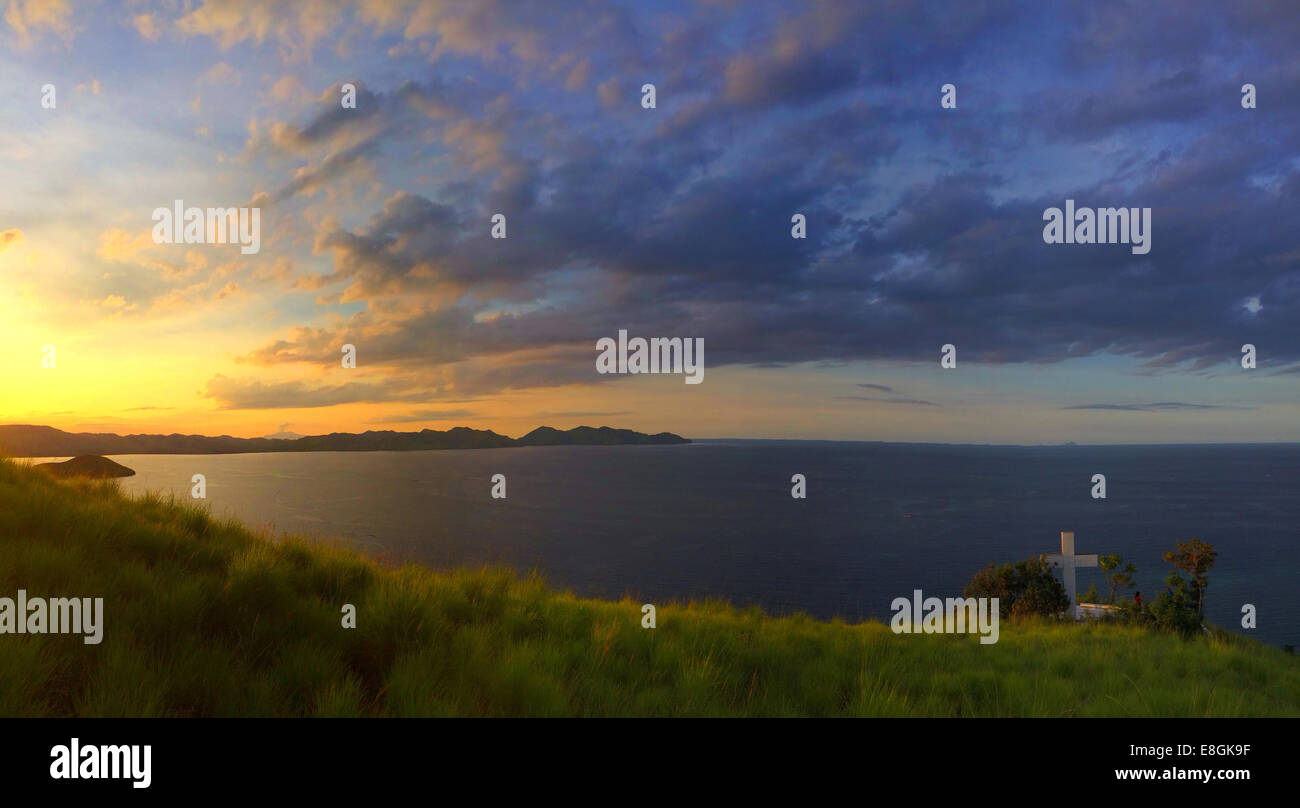Indonesia, Tenggara Maumere, East Nusa, Sunset on top hill - Stock Image