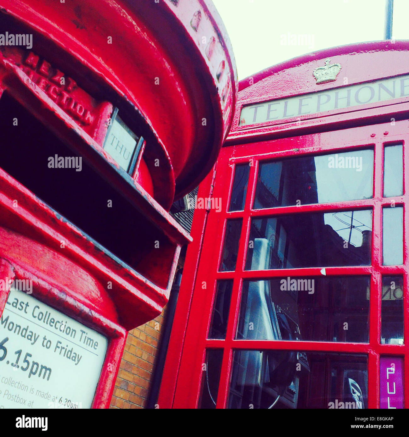 Red Letterbox And Telephone Box In England - Stock Image