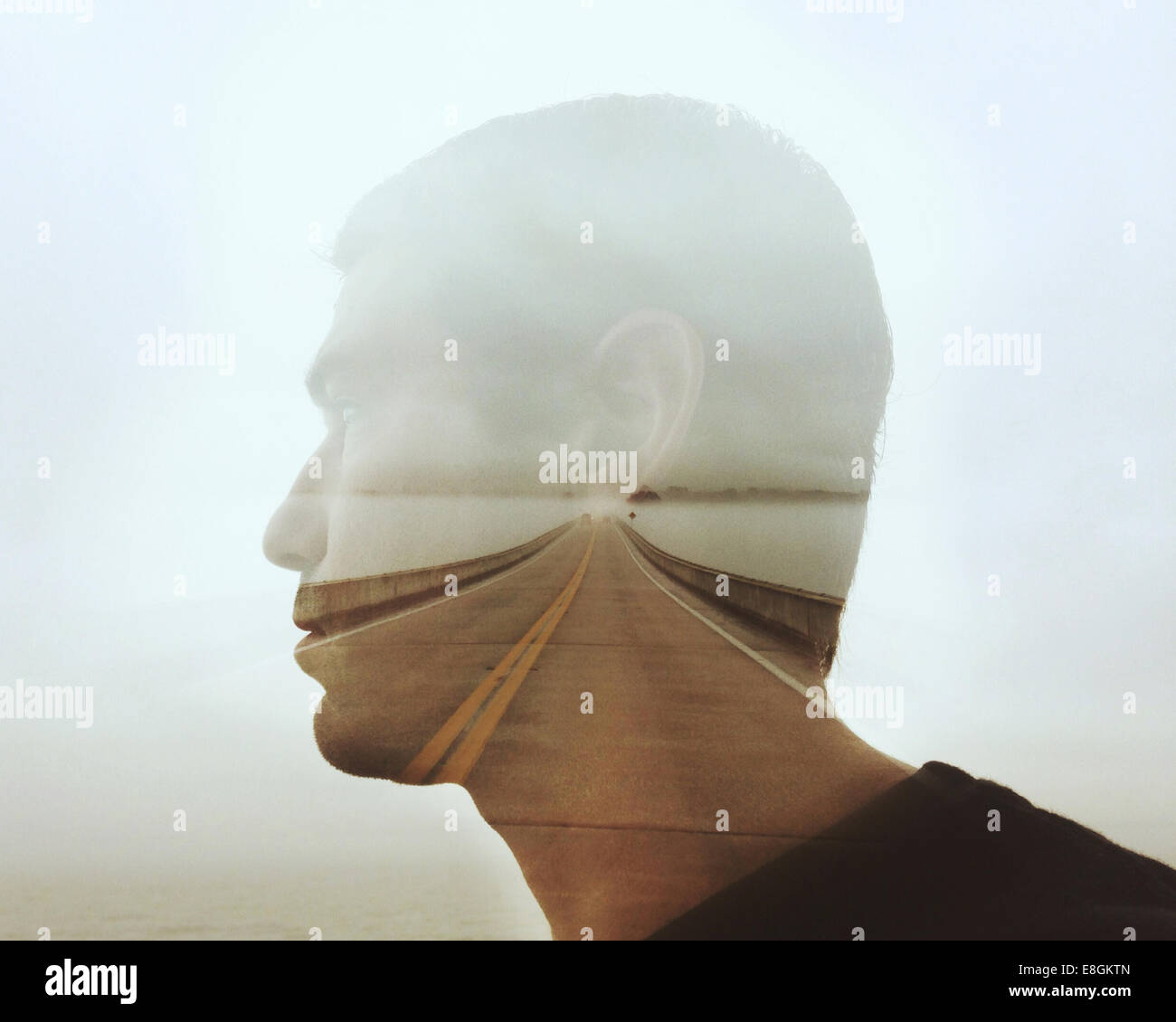 USA, Florida, Clay County, Green Cove Springs, Digital composite of man's face and highway - Stock Image