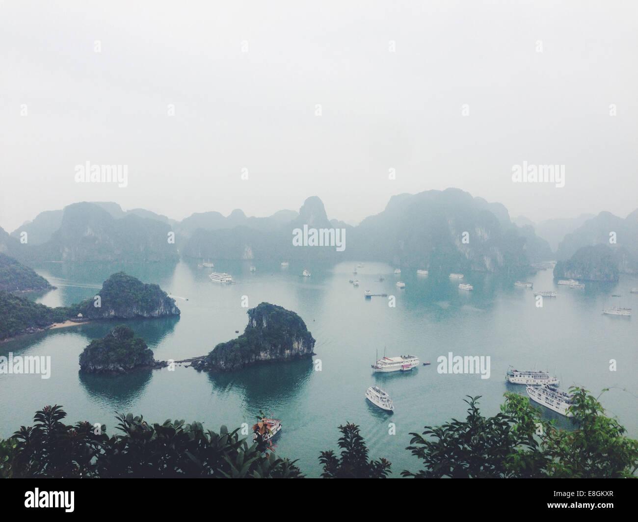 Vietnam, Quang Ninh Province, Halong, HaLong Bay, Elevated view of foggy bay - Stock Image