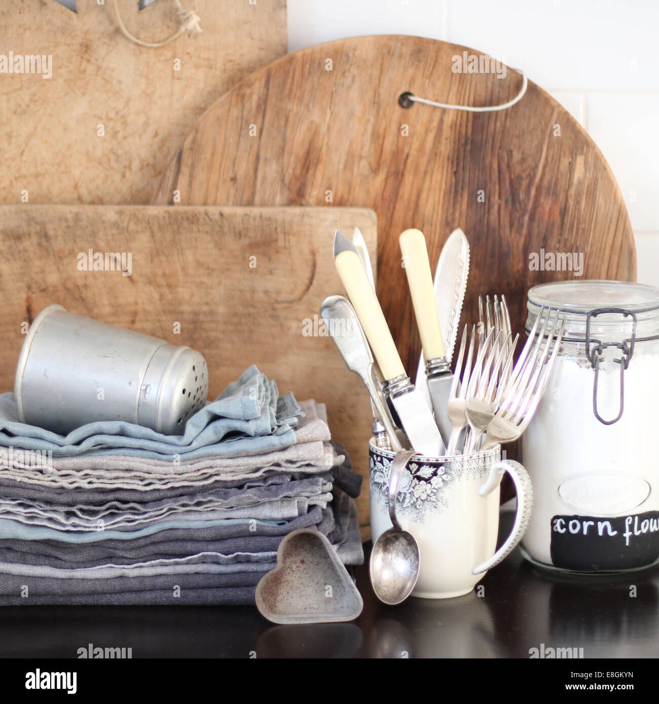 Chopping boards, napkins and cutlery - Stock Image
