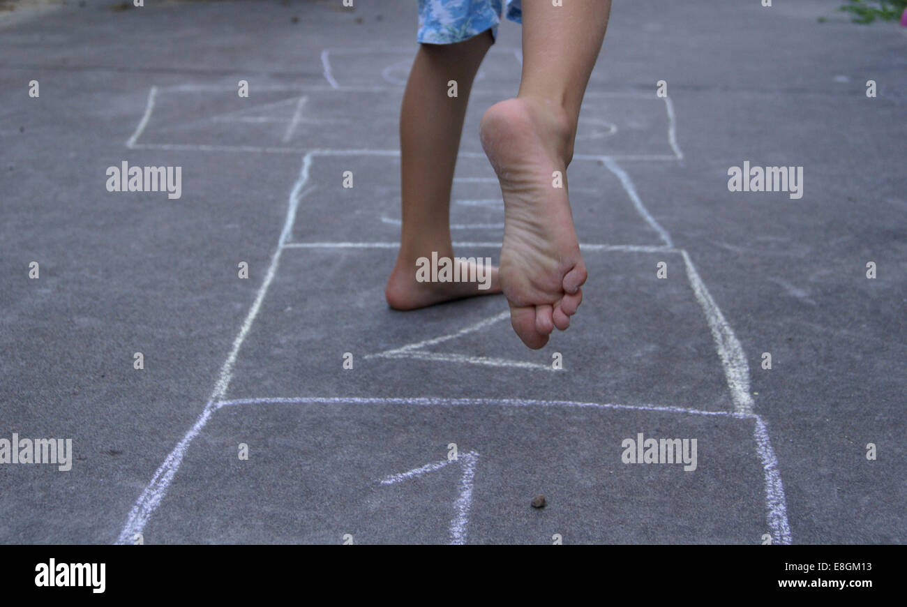 Child playing hopscotch - Stock Image