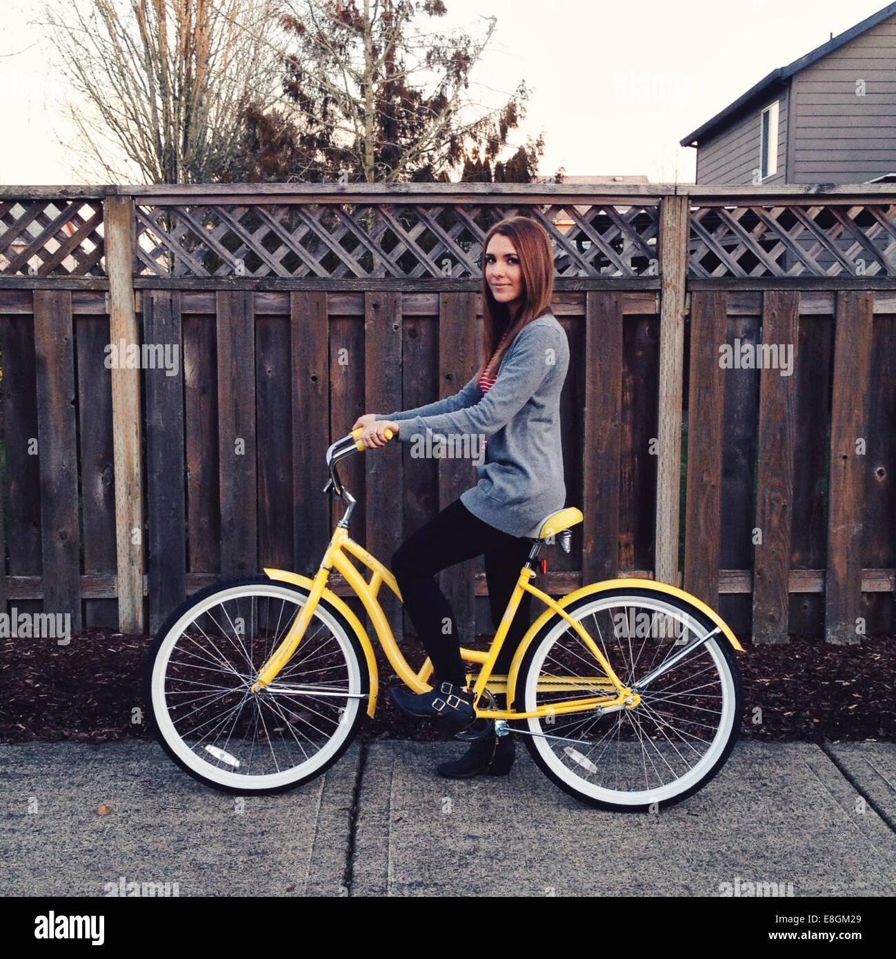 USA, Oregon, Multnomah County, Portland, Portrait of young woman riding bike - Stock Image