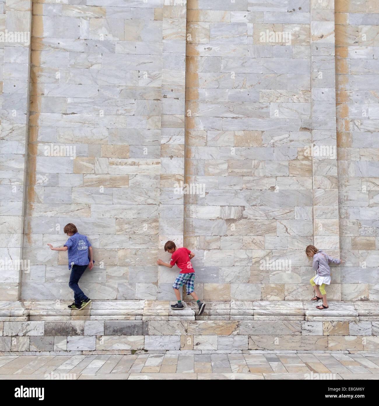 Italy, Tuscany, Pisa, Three adventurers (10-11, 12-13) - Stock Image