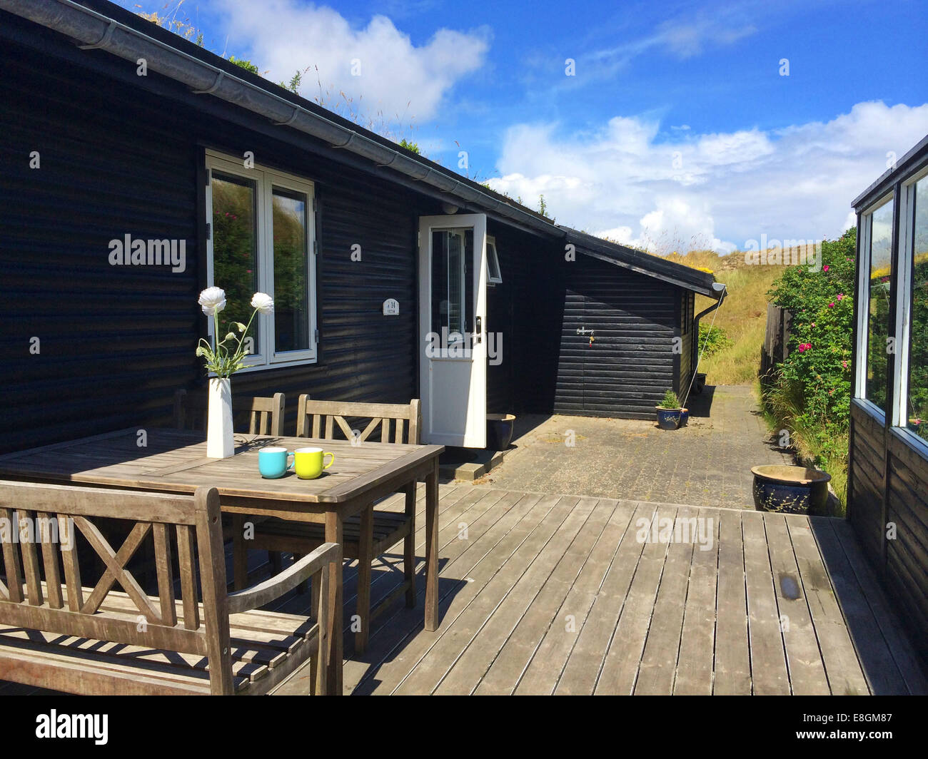 Summerhouse terrace with table and chairs, Fanoe, Denmark - Stock Image