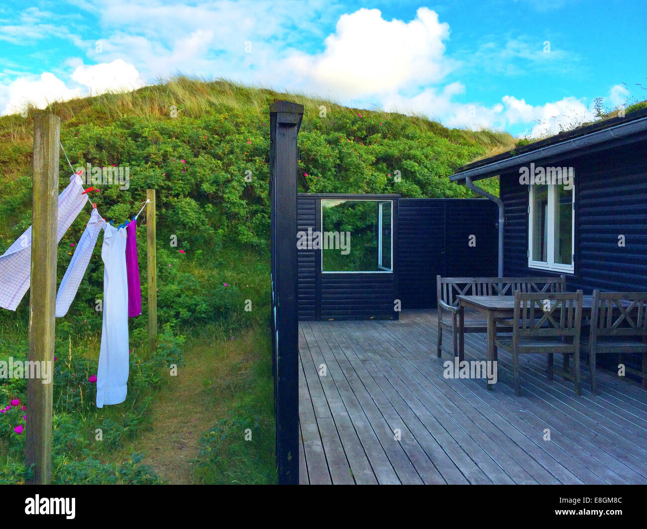 Towels hanging on washing line outside summerhouse, Fanoe, Denmark - Stock Image