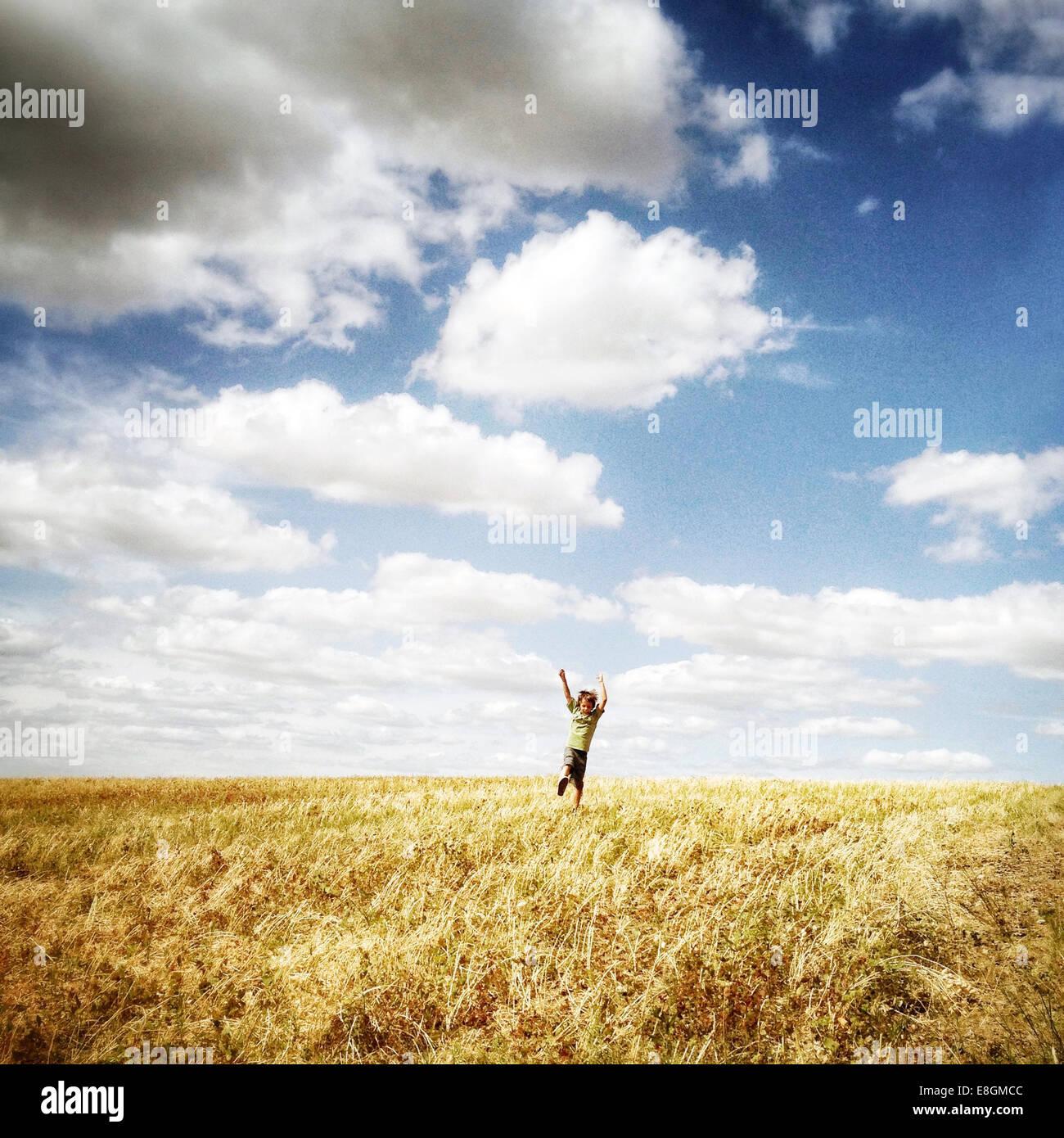 Happy boy in field - Stock Image