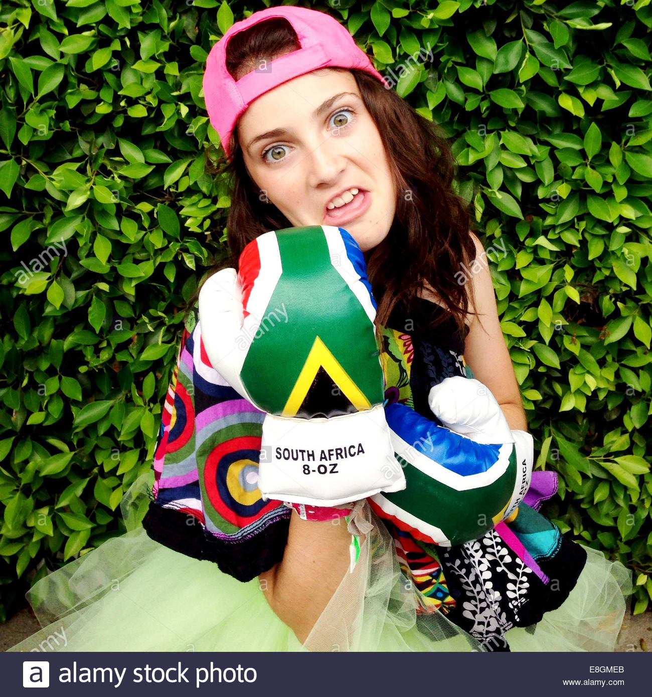 Girl wearing South African boxing glove - Stock Image
