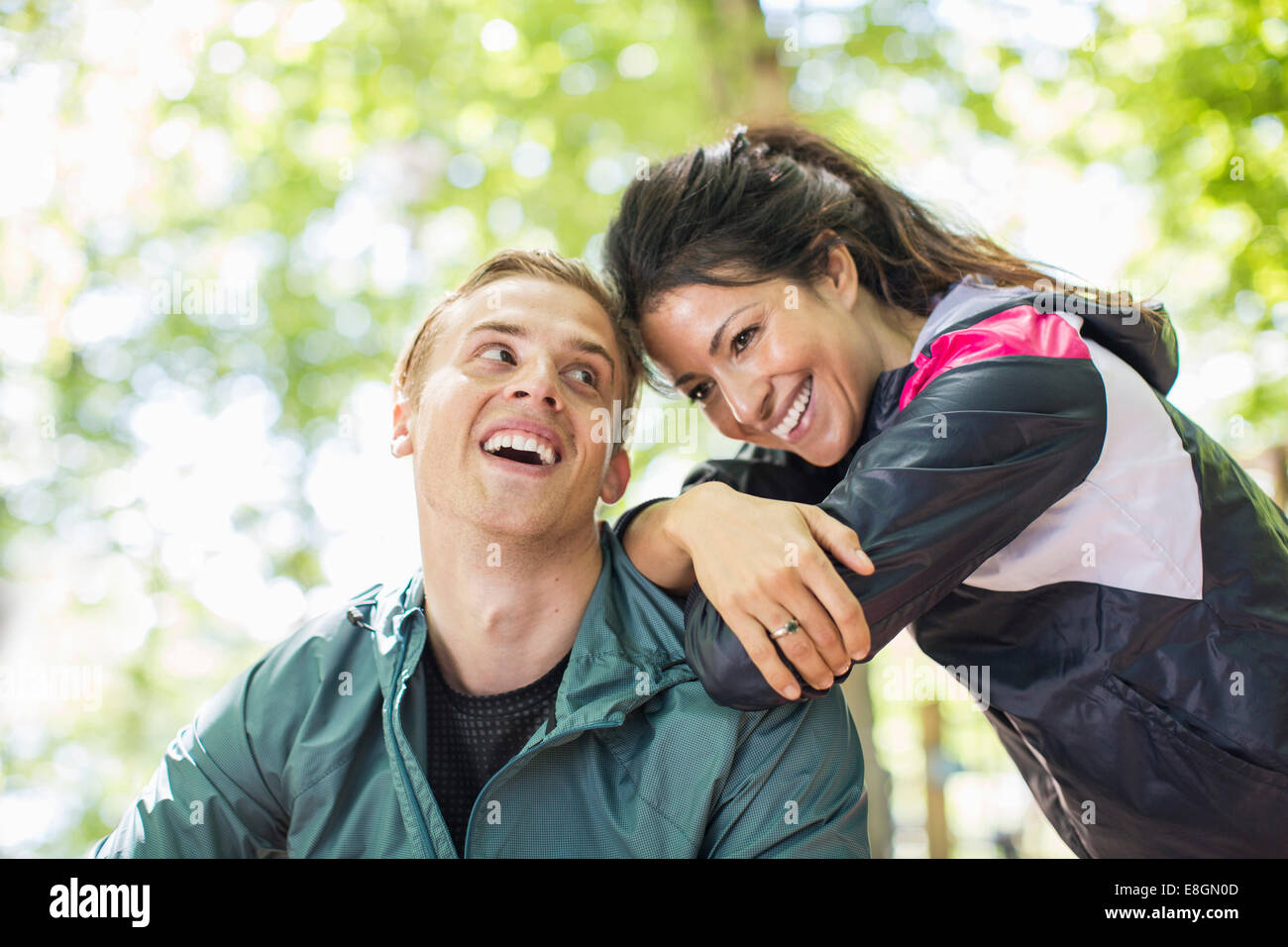 Happy multi-ethnic fit couple outdoors - Stock Image