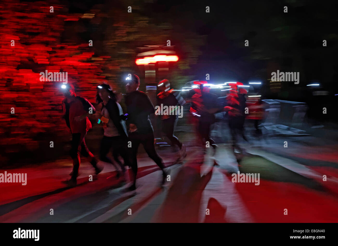 Runners wearing headlamps during a night run, Landschaftspark Duisburg-Nord, landscape park at a disused industrial - Stock Image